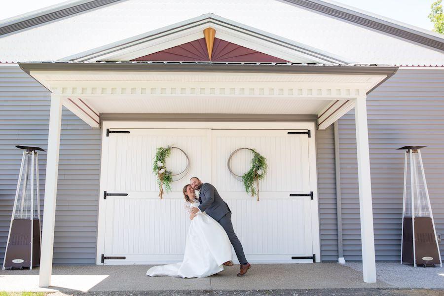 The Oakley Wedding Venue barn doors couple dipping