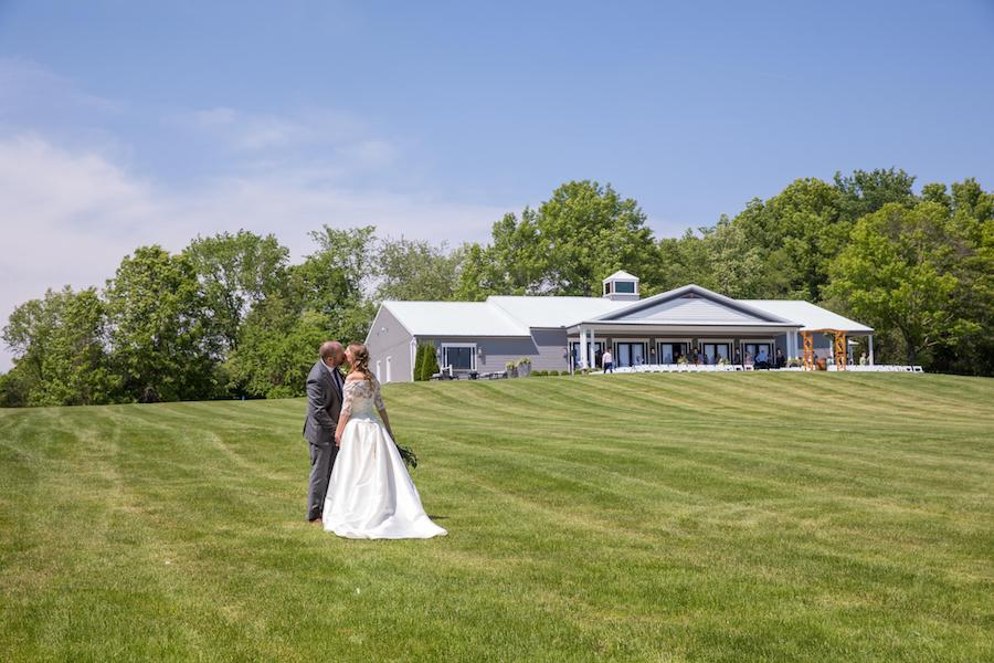 The Oakley Wedding Venue bride and groom kissing on the grounds