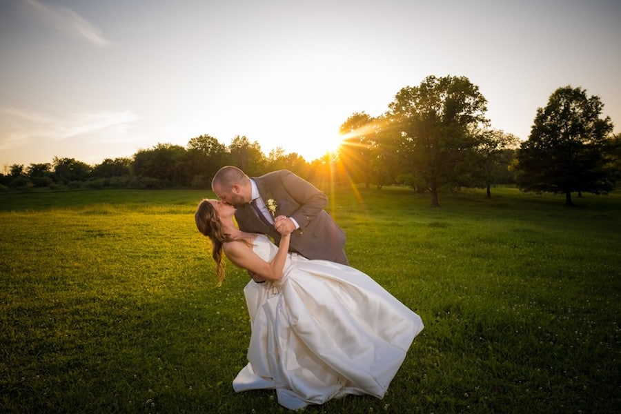 The Oakley Wedding Venue bride and groom kissing sunset