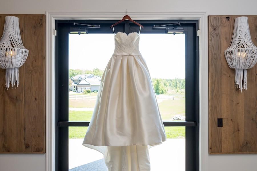 The Oakley Wedding Venue dress hanging barn door