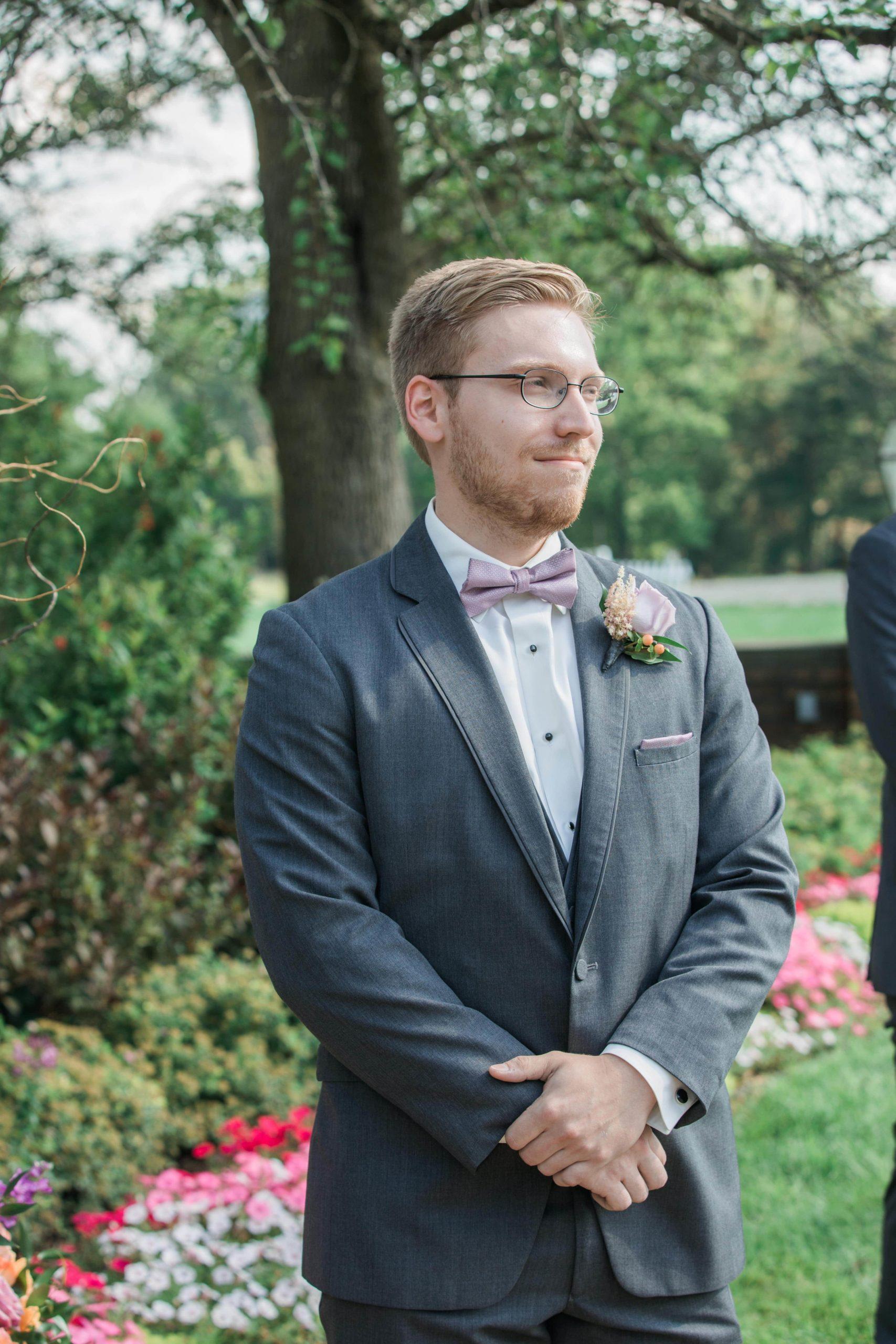 outdoor wedding ceremony groom
