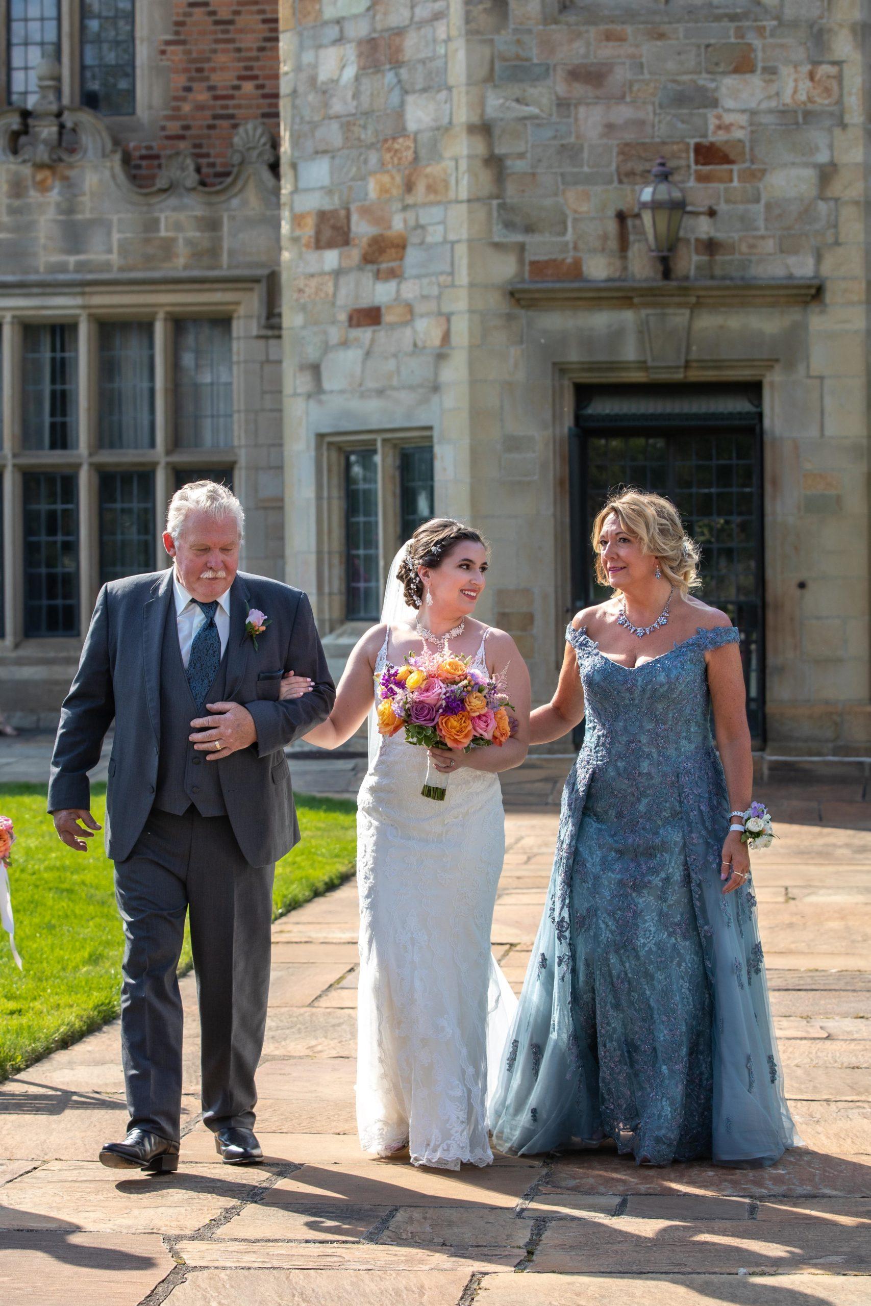 bride walking down the aisle parents
