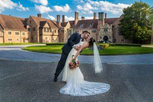 bride and groom kissing meadow brook hall