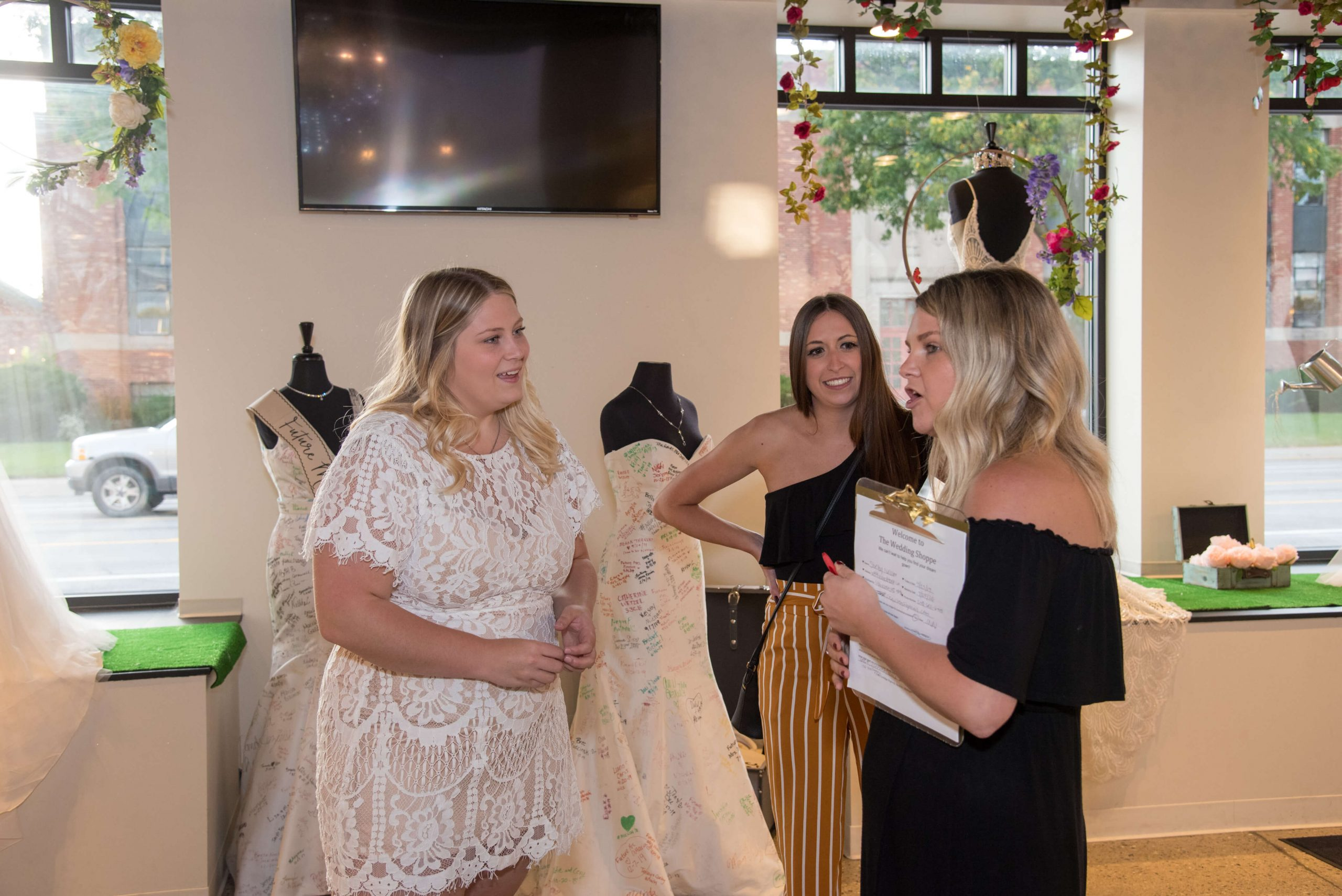 Staff talking with bride