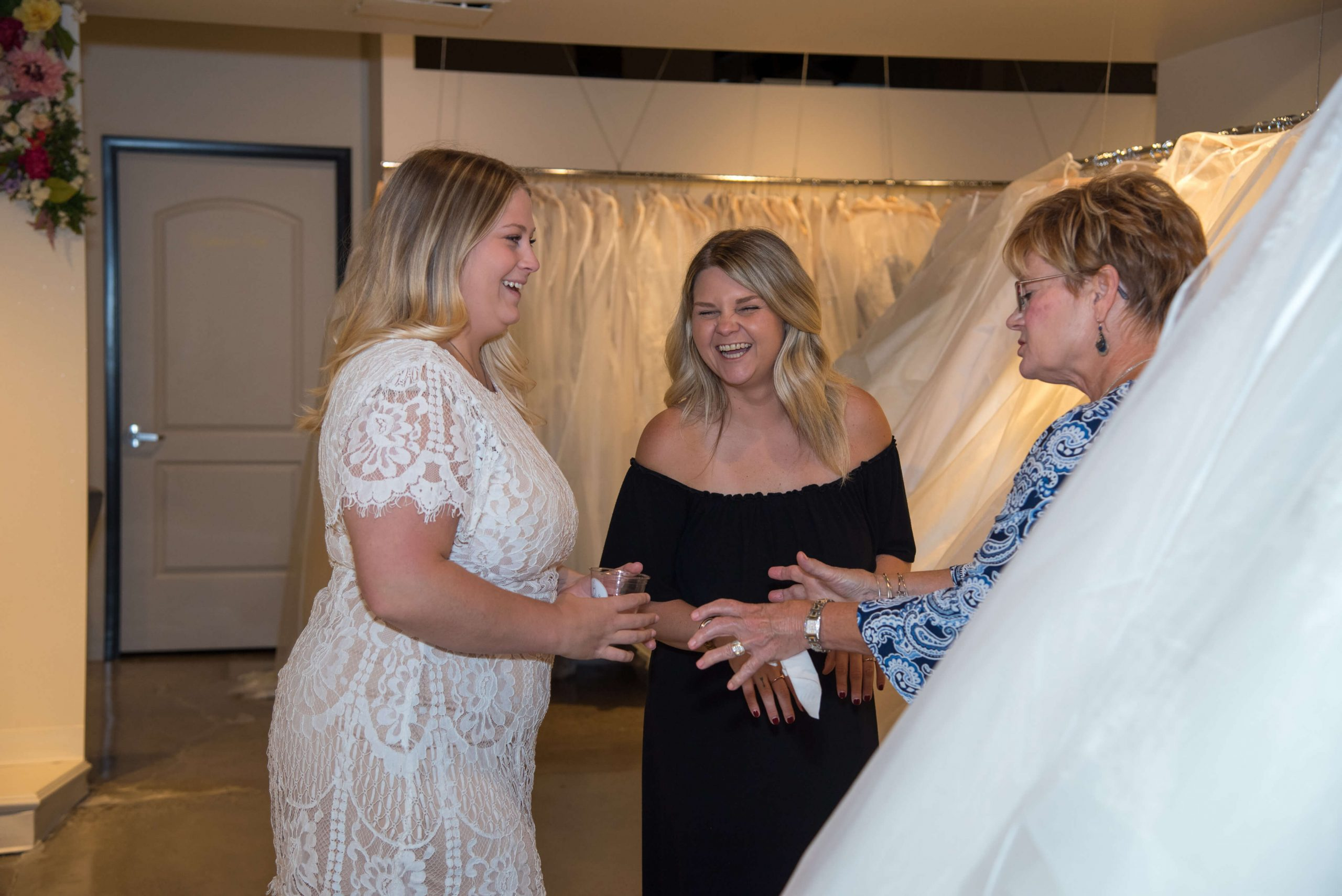 Bride talking with mom and sales woman