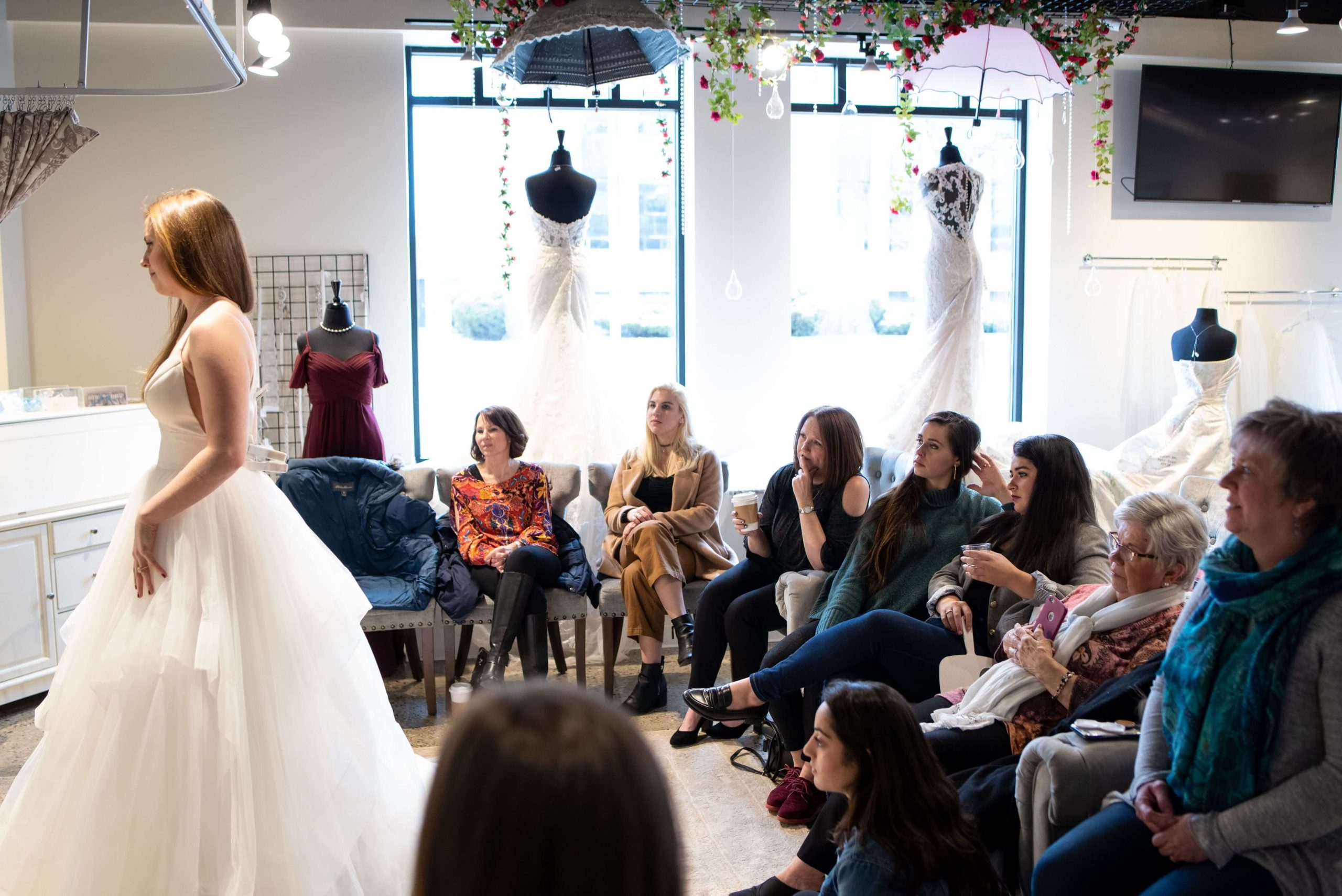 bride in dress with guests looking at her