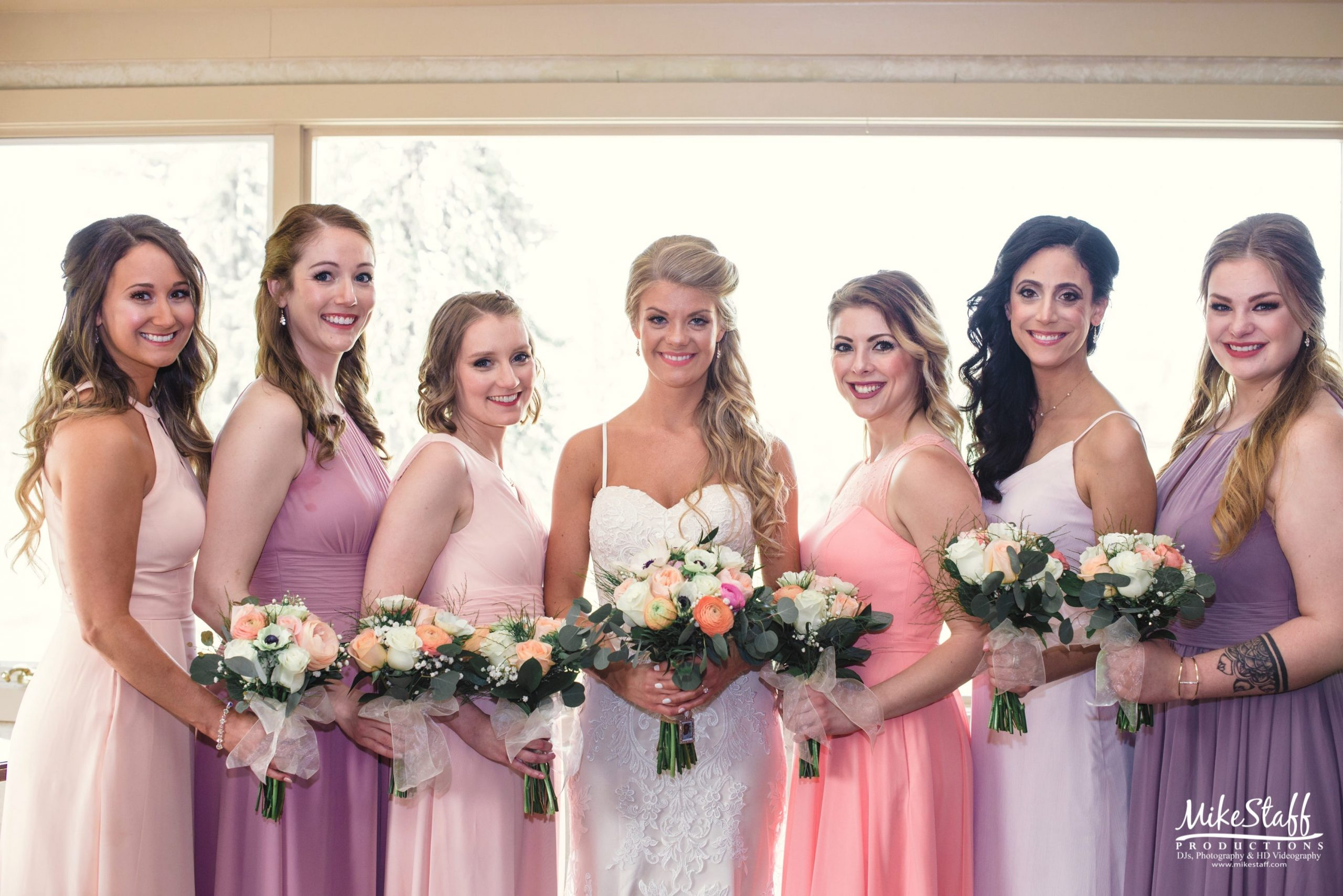 bride with bridesmaids in pastels