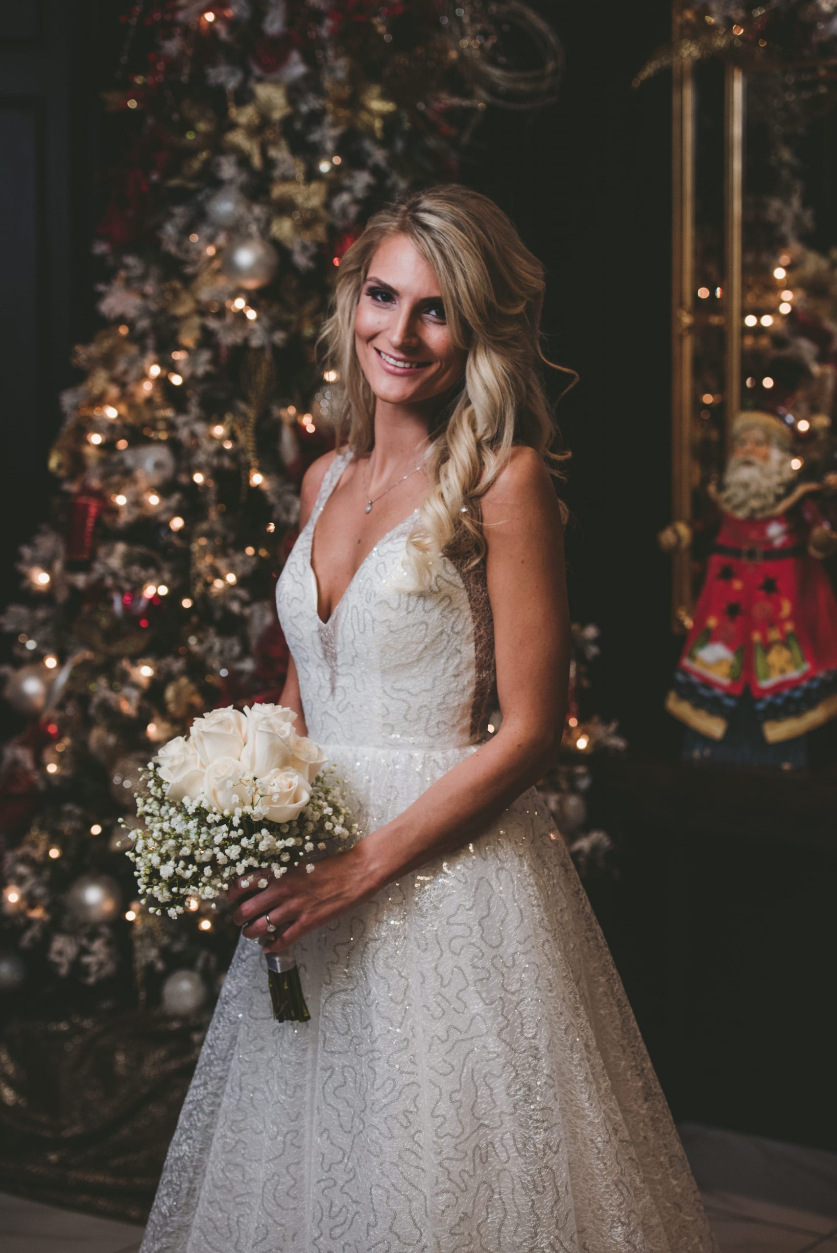 bridal photography in front of Christmas tree