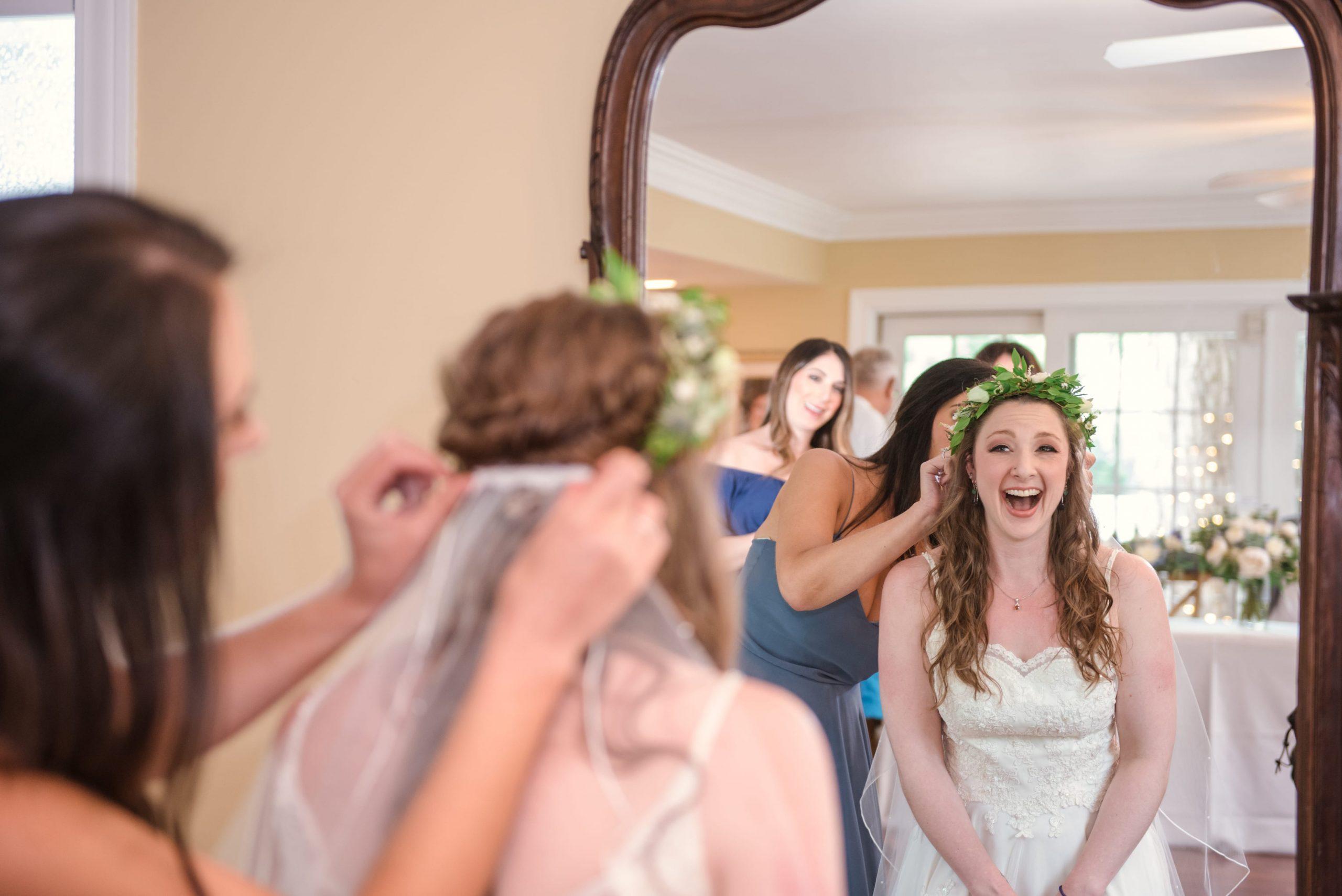 bride's excitement looking in mirror pre-ceremony