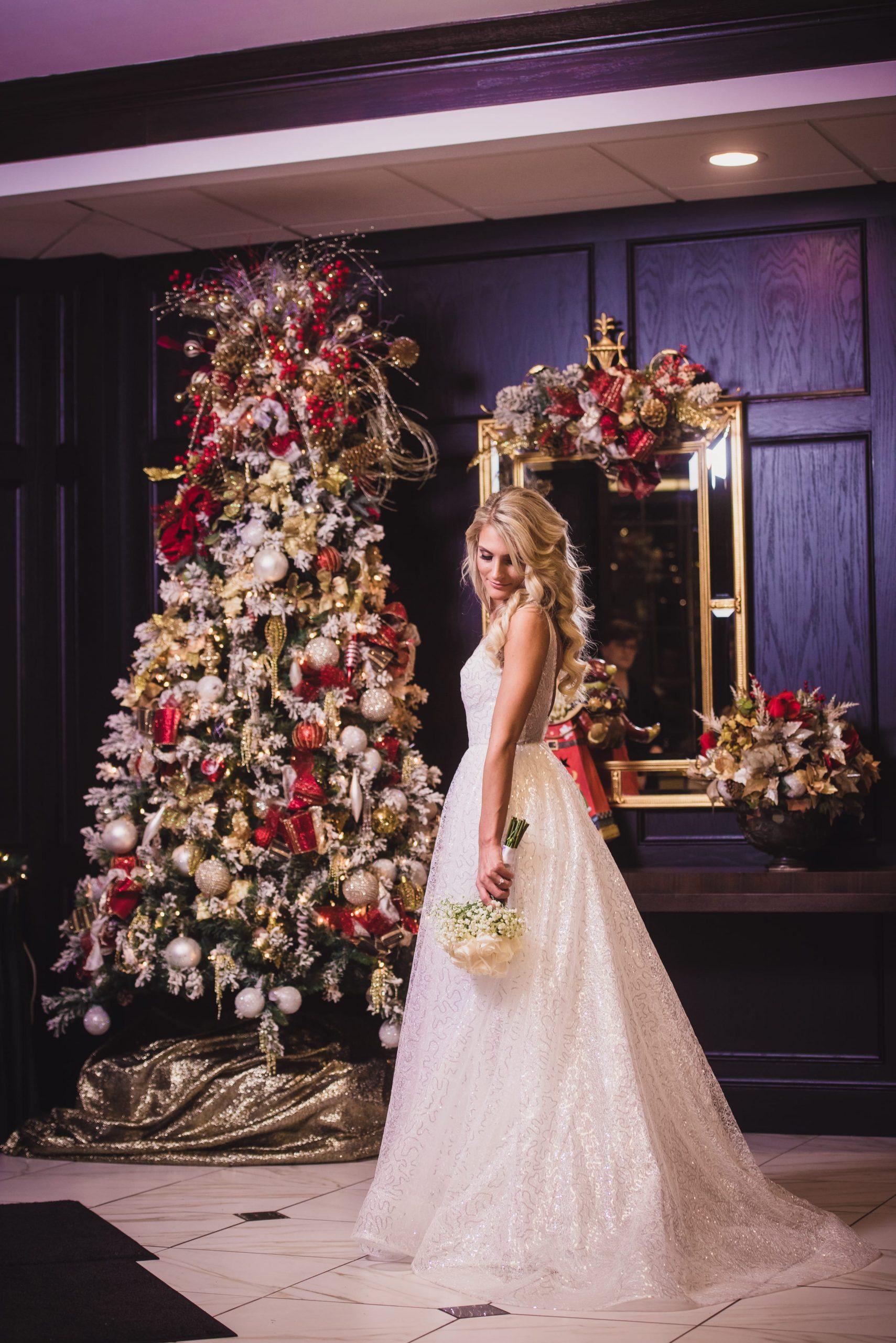 bride by Christmas tree