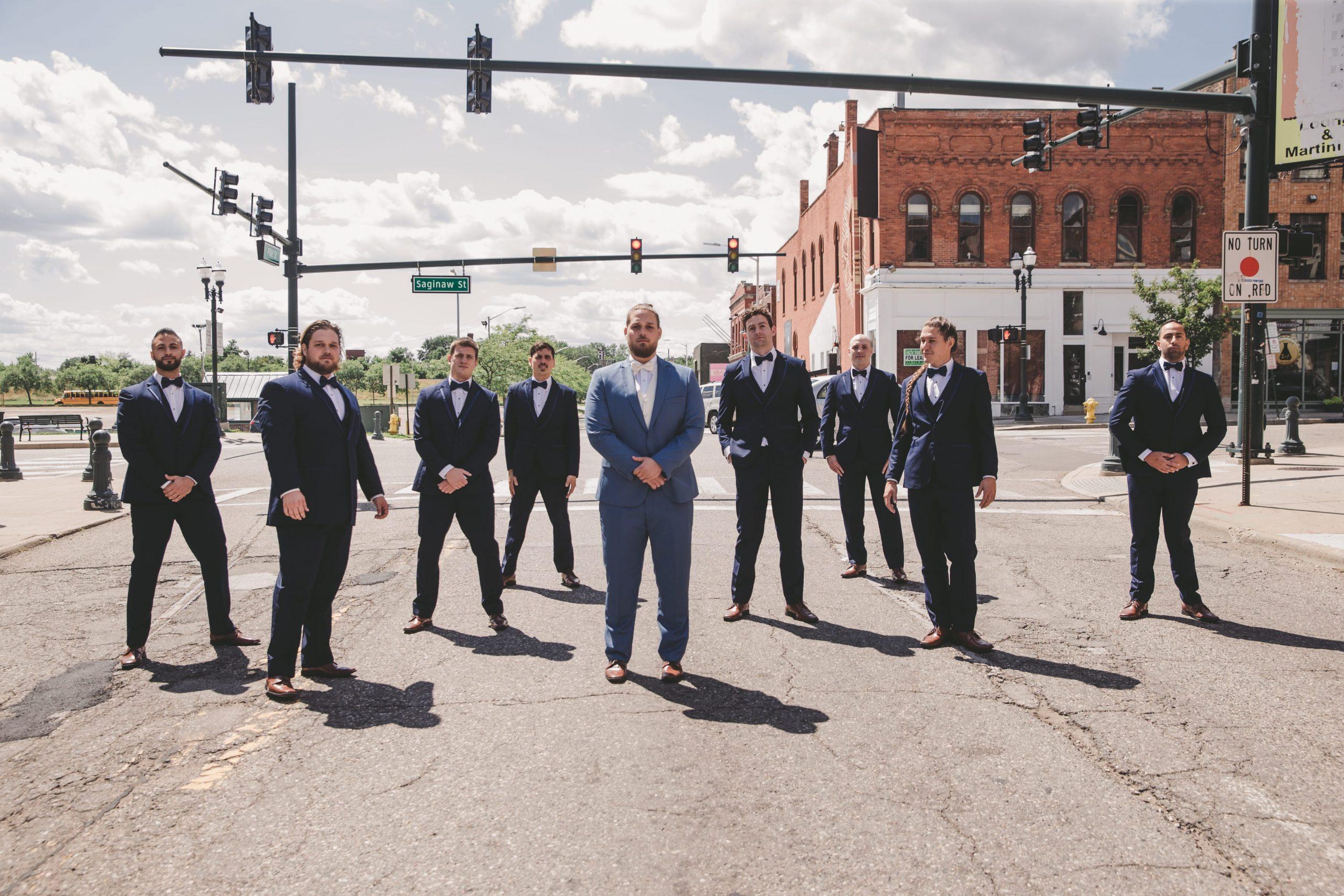 groomsmen in street