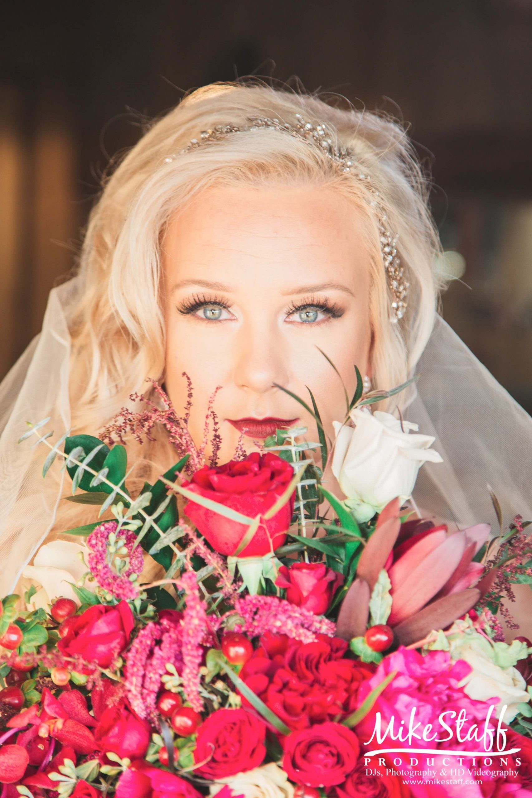 bride close up looking with bouquet