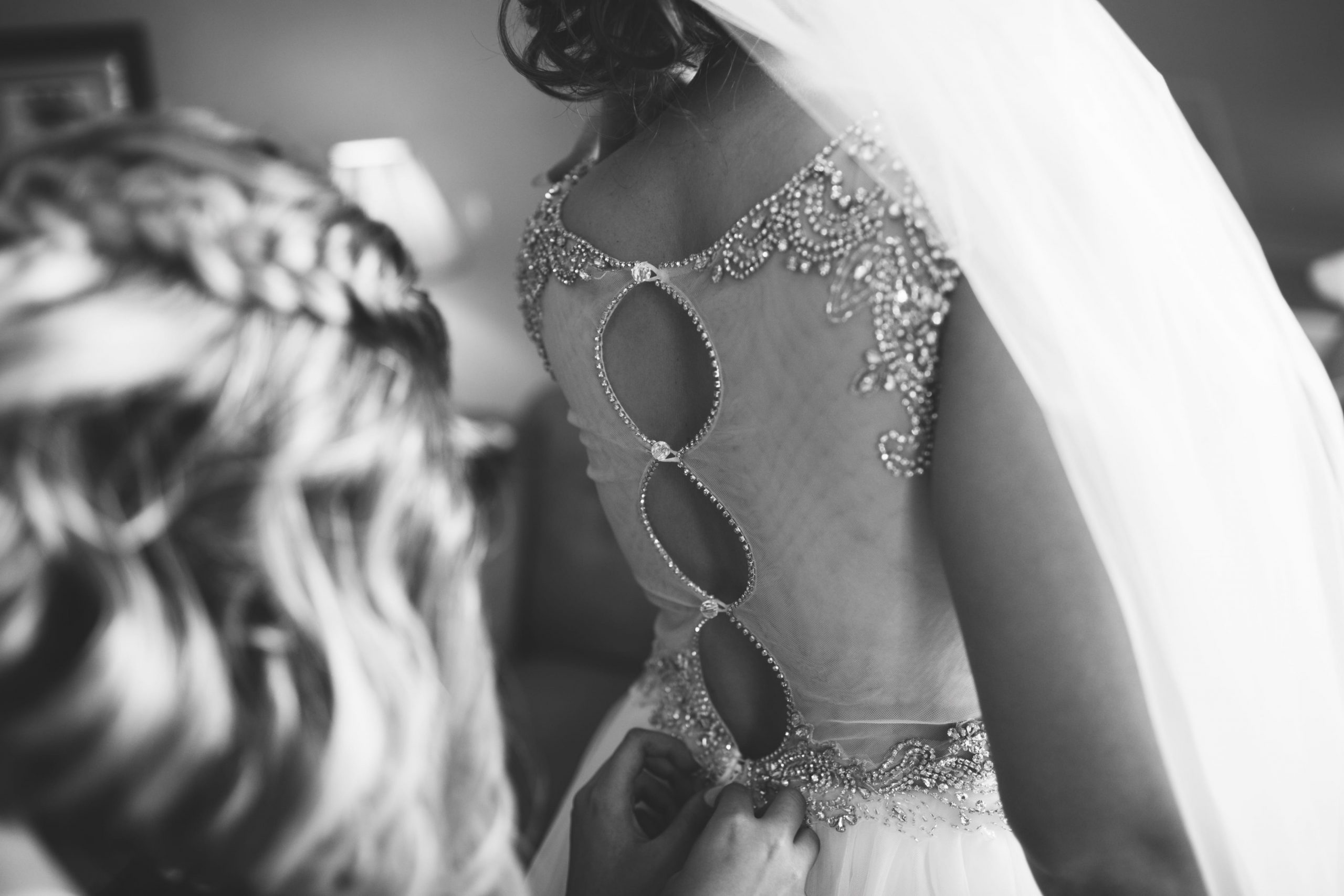 black and white photo of bride's gown details