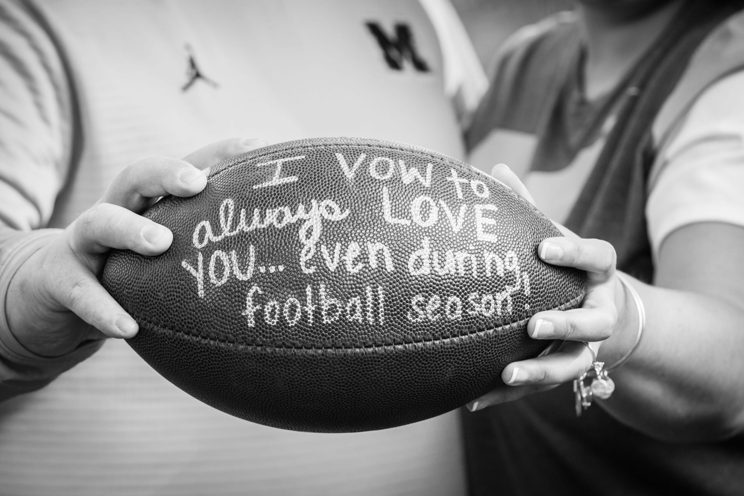 football prop in engagement photo