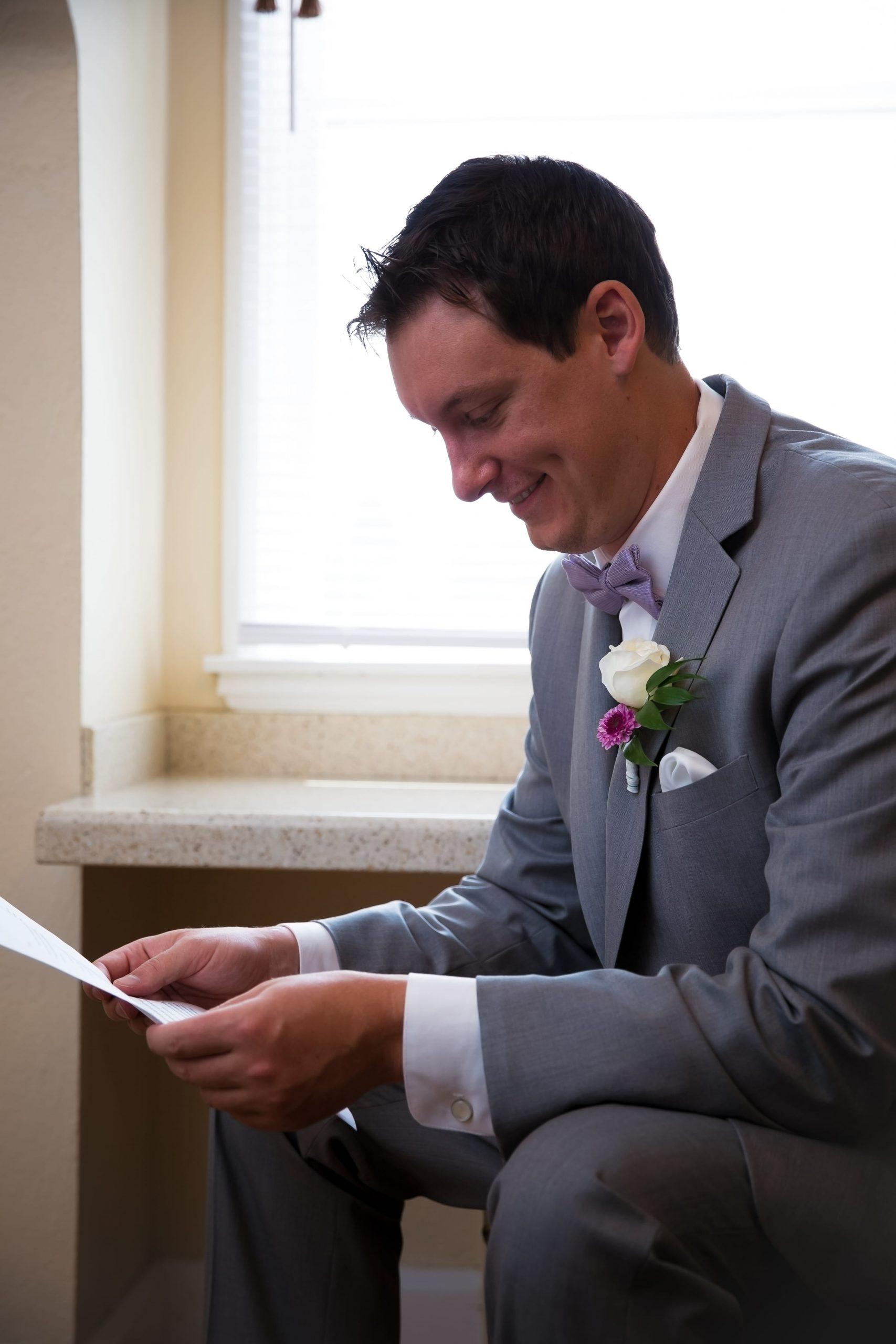 groom reading letter pre-ceremony