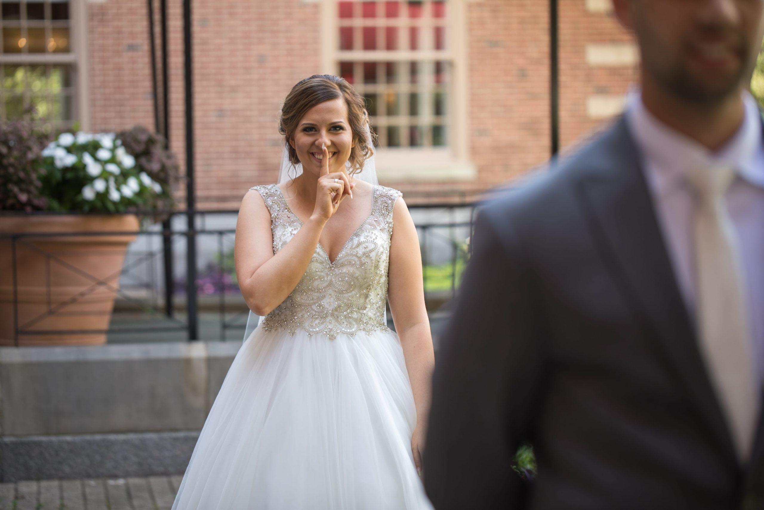 bride behind groom before first look
