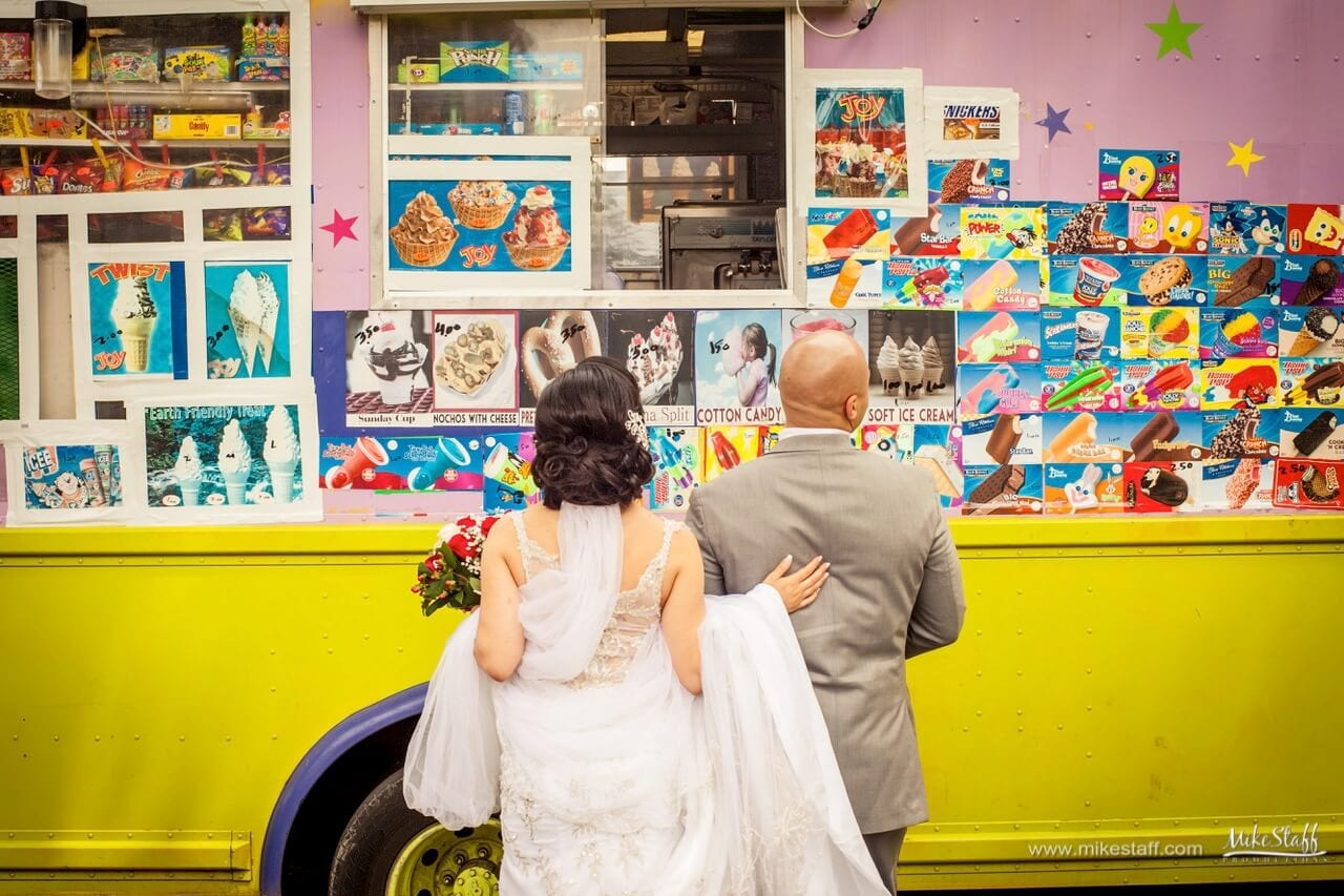 bride and groom in front of ice cream truck