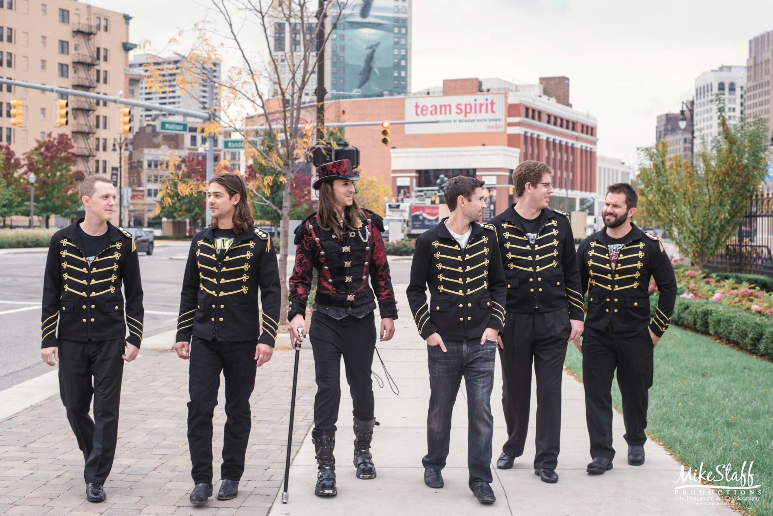 groom and groomsmen walking in detroit