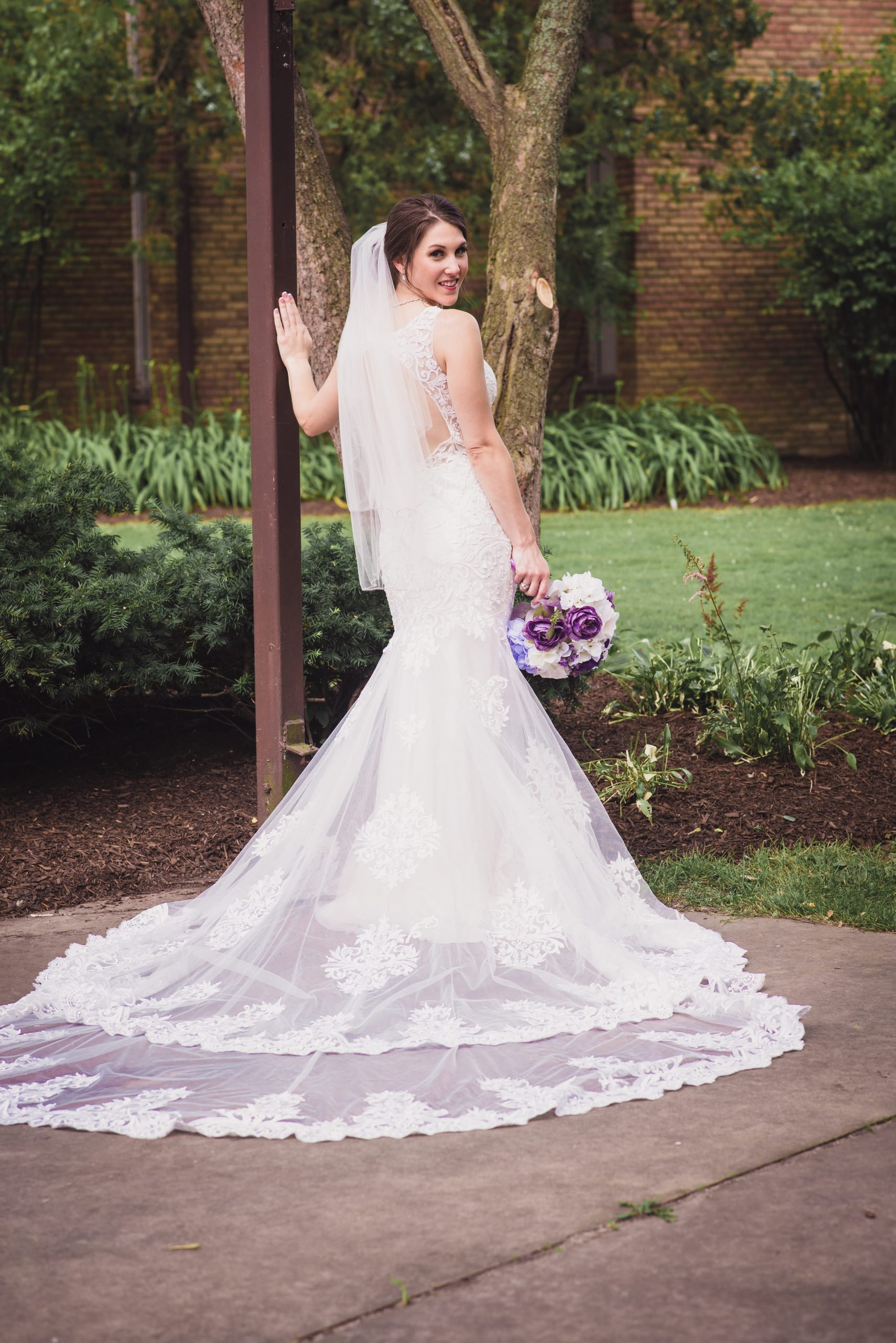 bride looking back in portrait, showing dress details