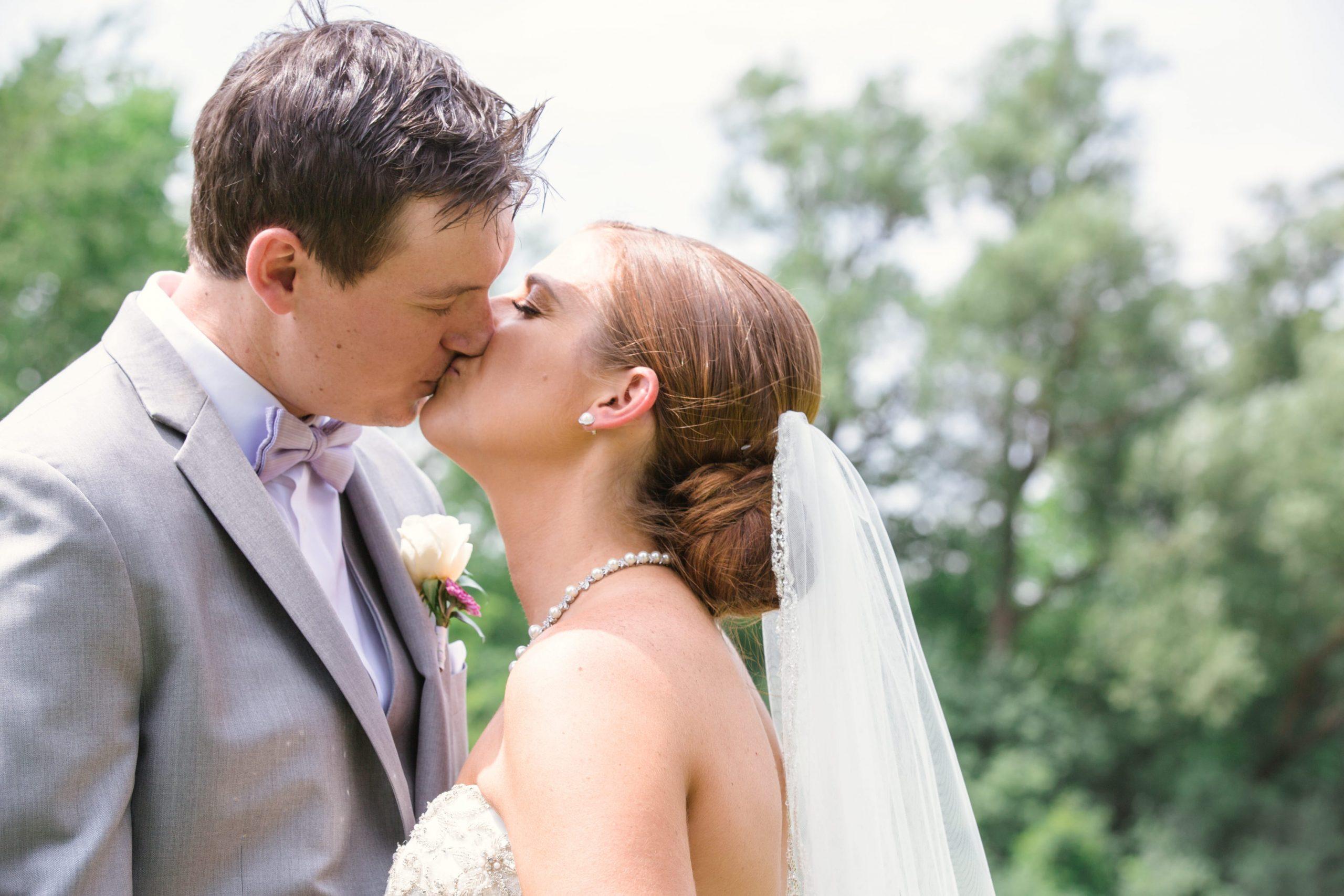 bride jamie and groom brett kissing