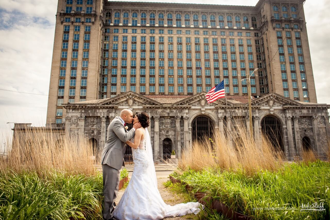 bride and groom in front of train station detroit