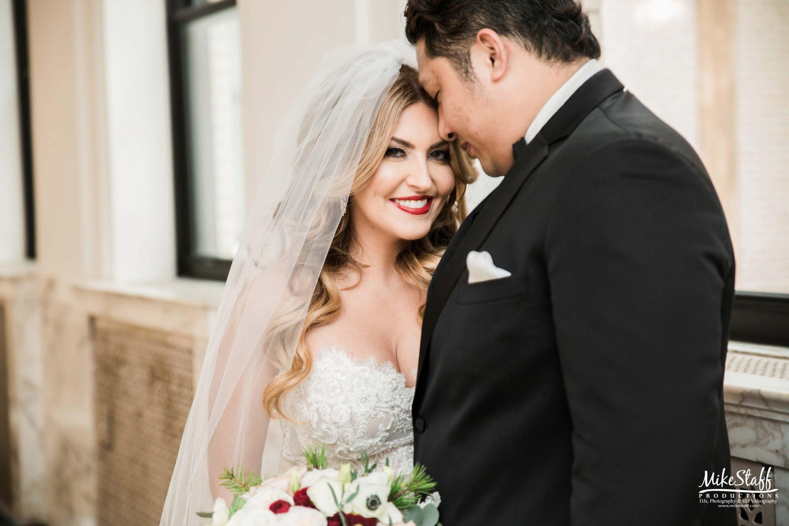 bride leaning head on groom