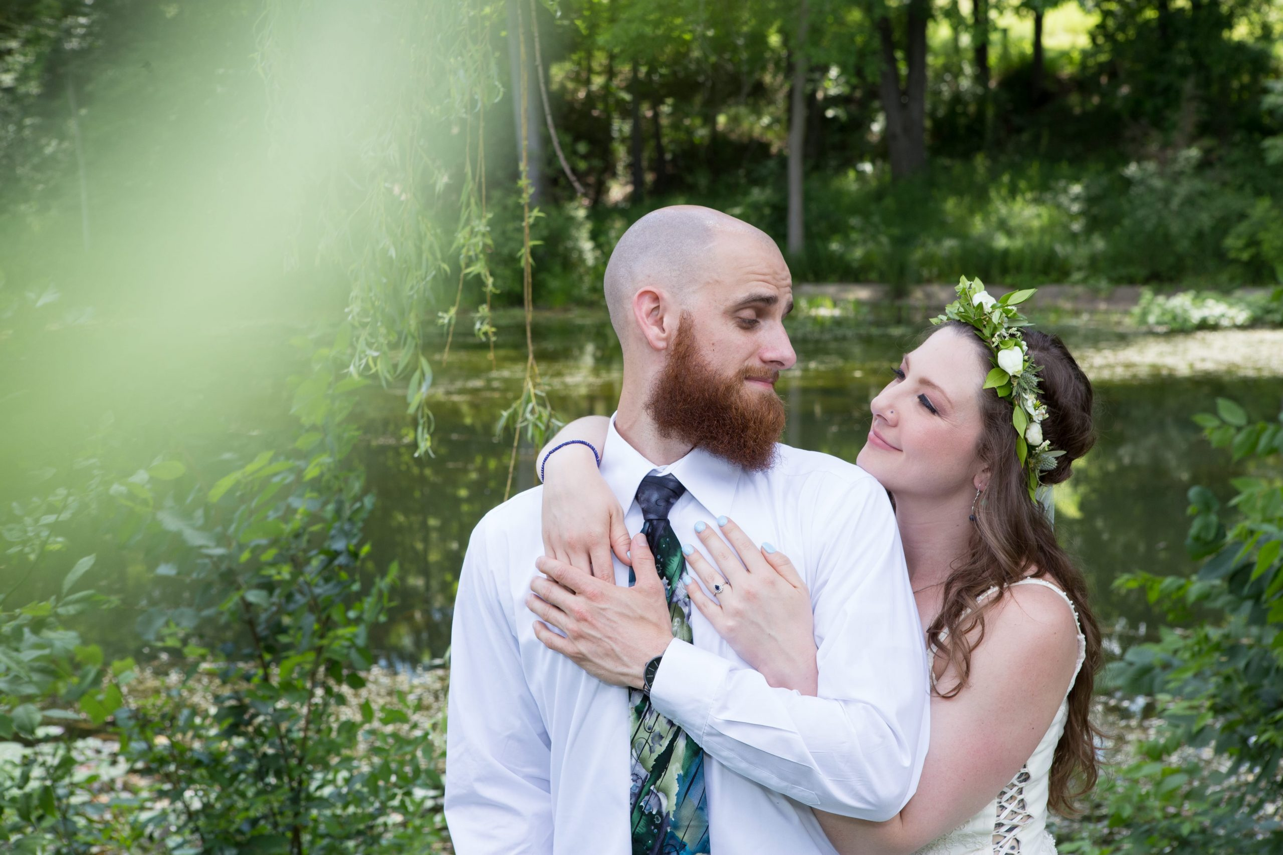 bride and groom embracing during wedding romantics session