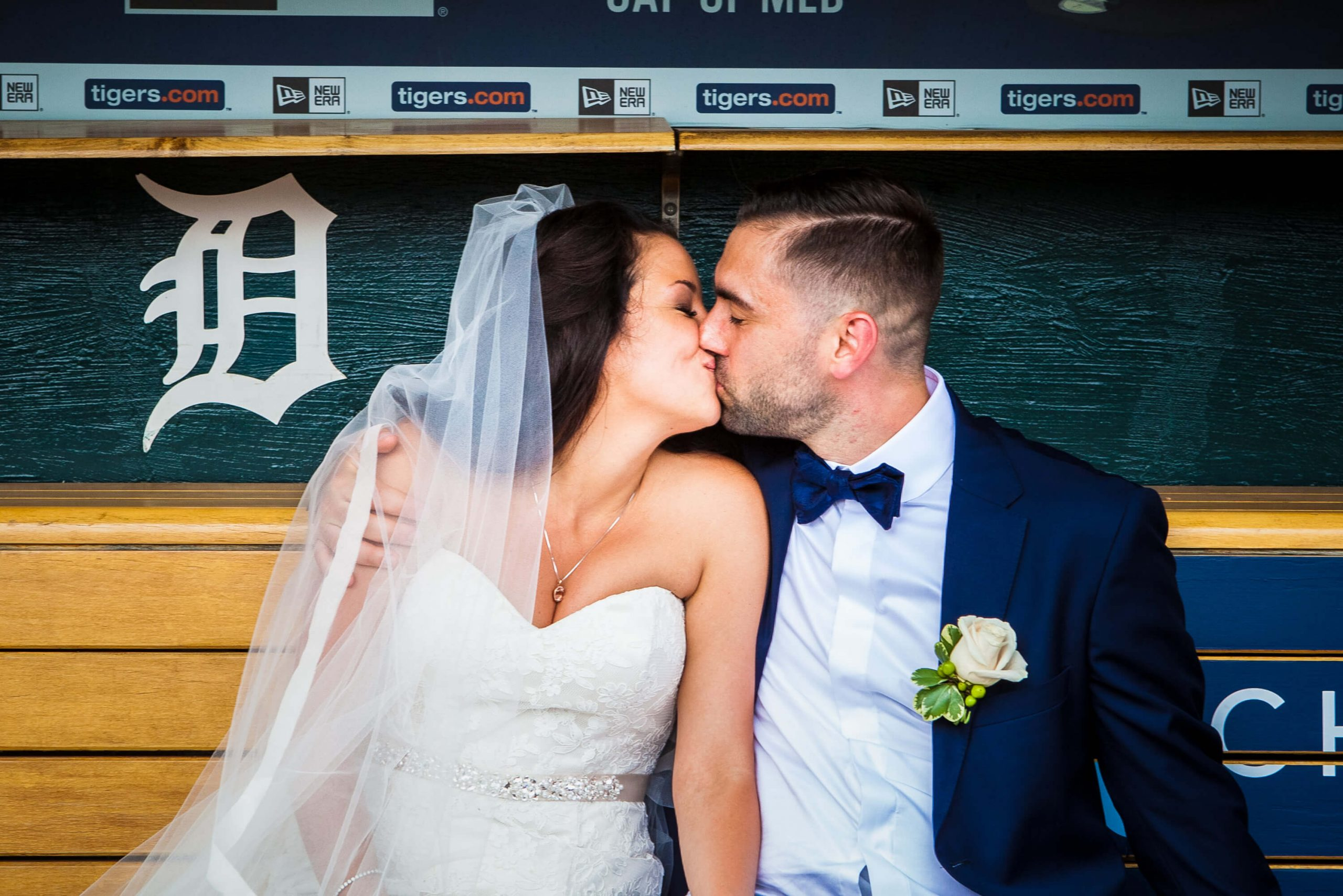 bride and groom kissing detroit tigers dugout