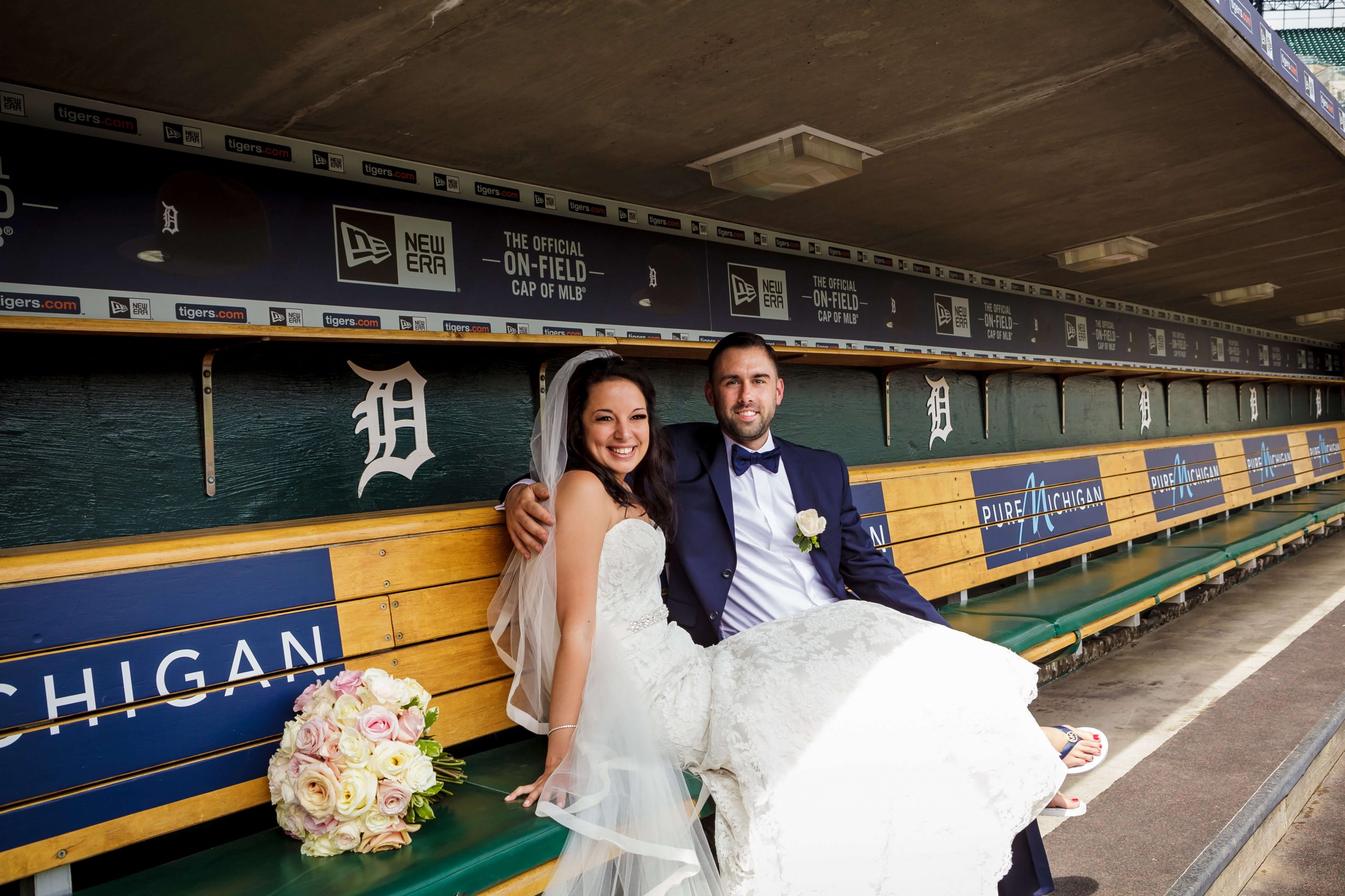 bride and groom in detroit tigers dugout