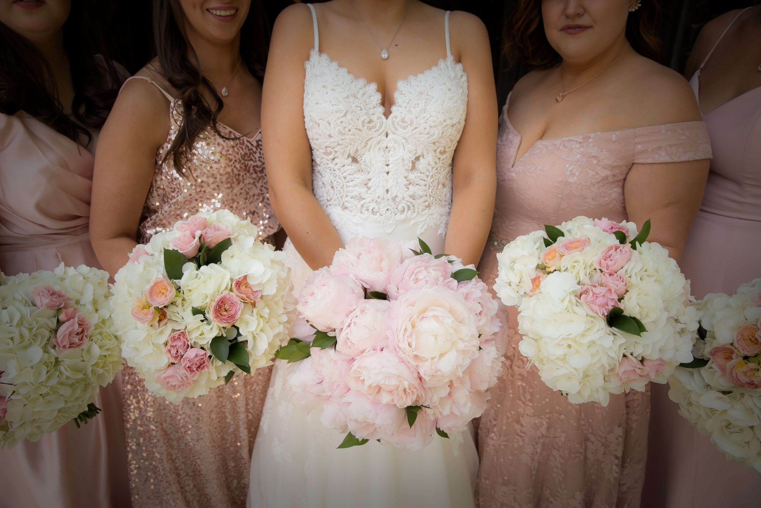 bride and bridesmaids in pink with bouquets