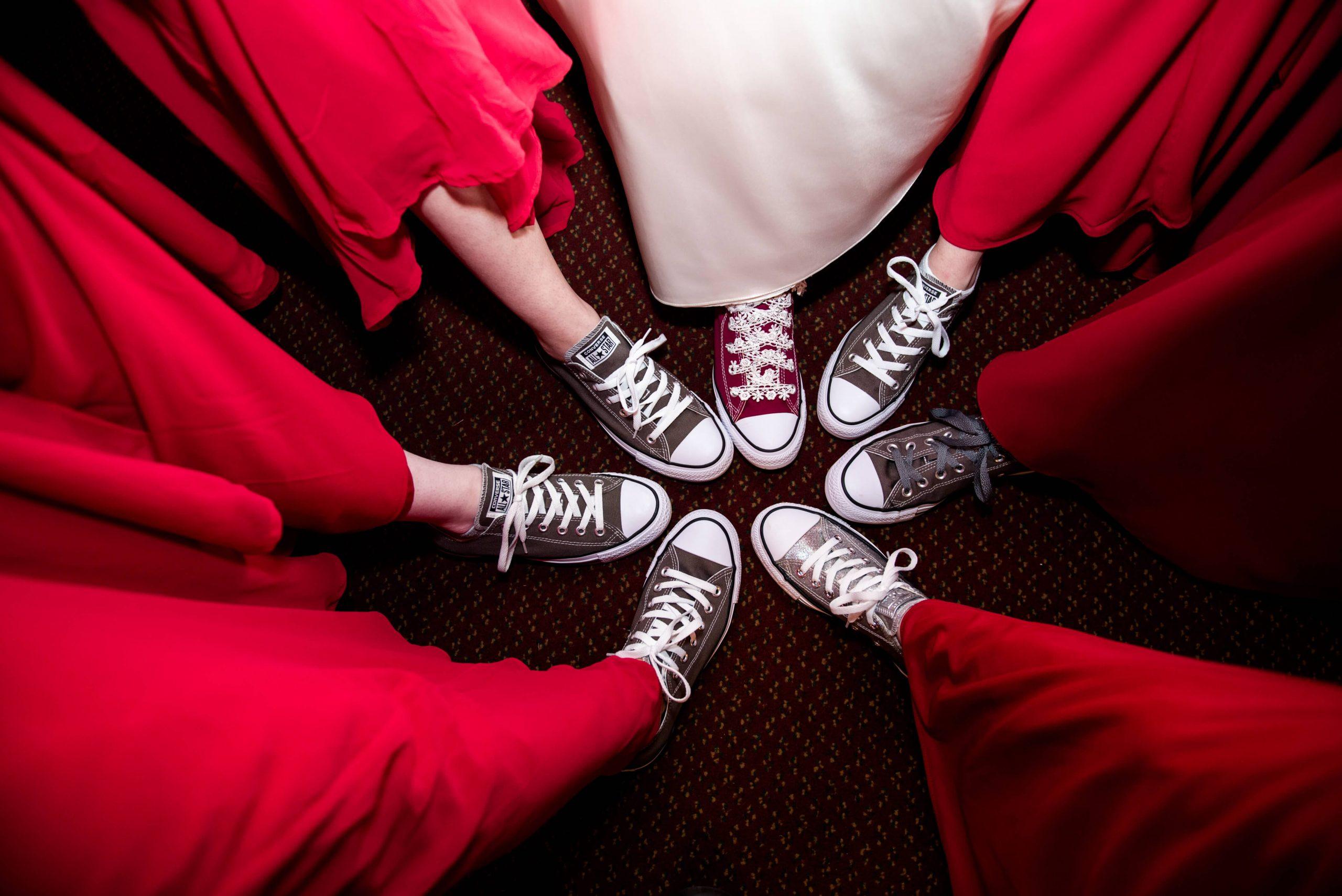 bride and bridesmaids wearing converse
