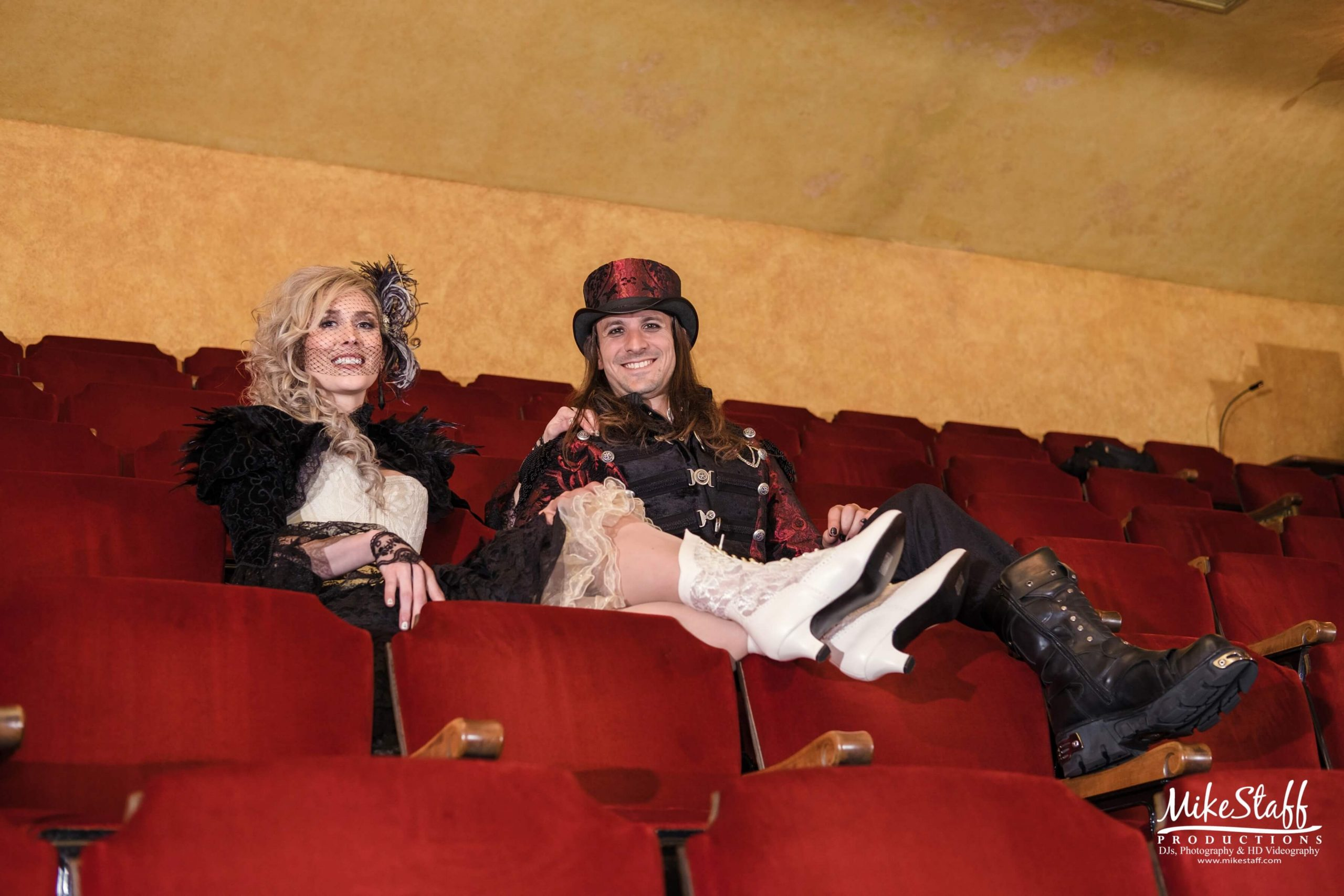 couple in costumes sitting in seats at gem theatre