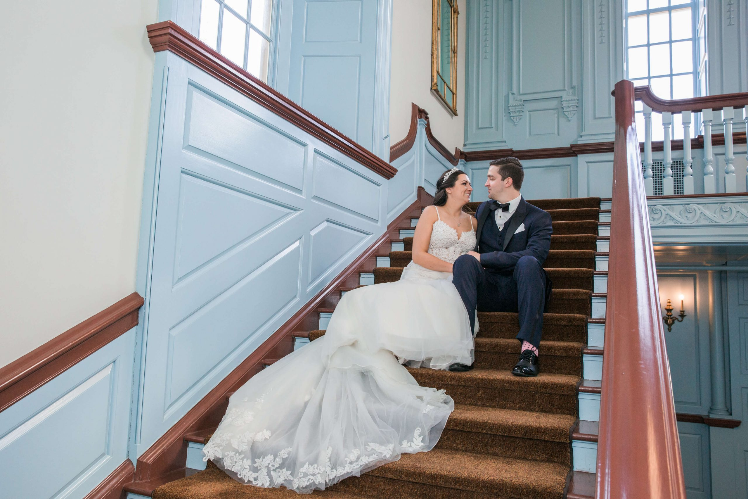 bride and groom sitting on steps at henry ford