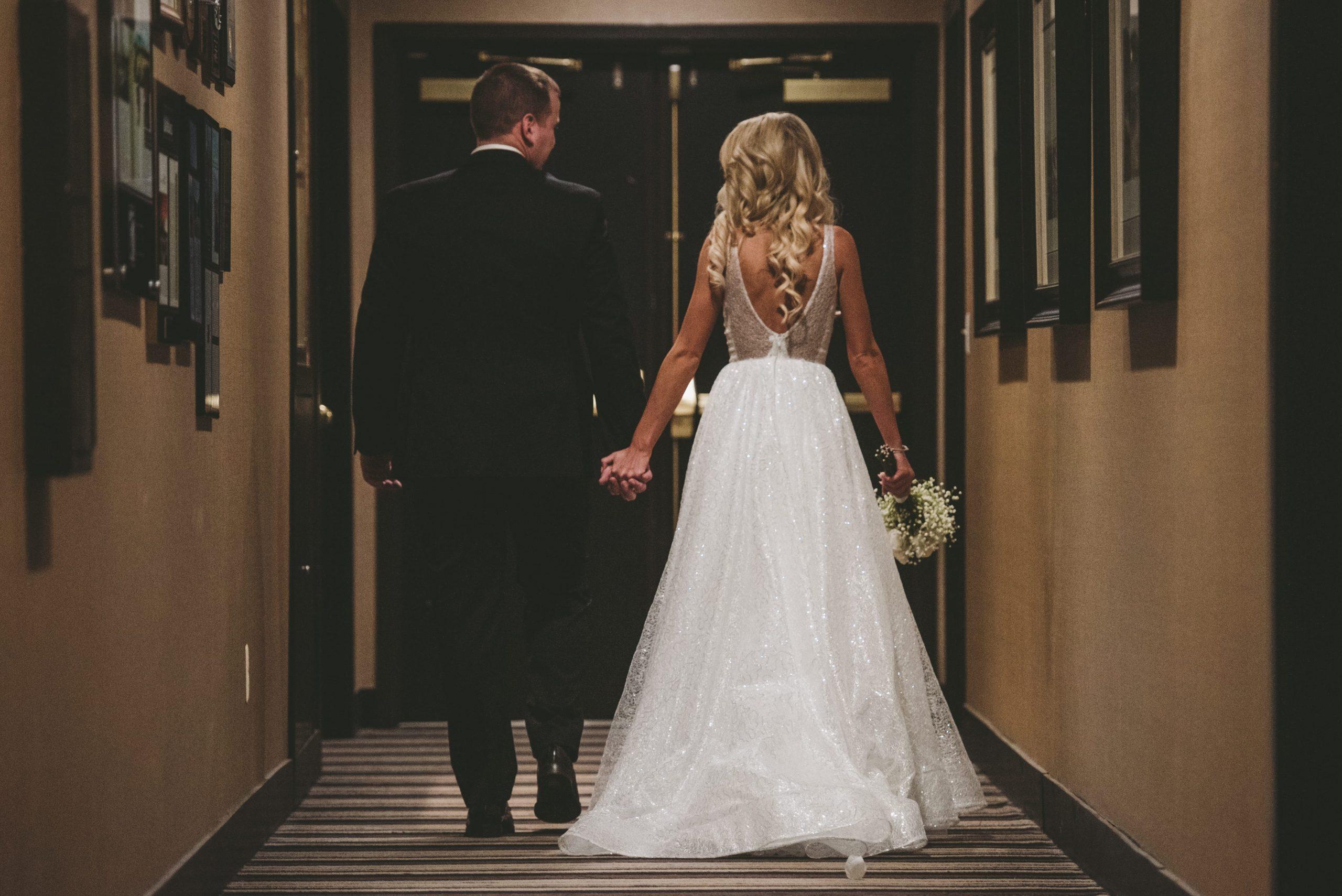 bride and groom walking wedding photo