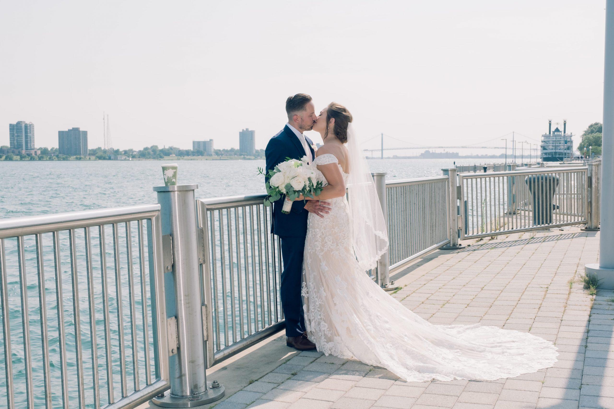 bride & groom kissing at detroit riverfront