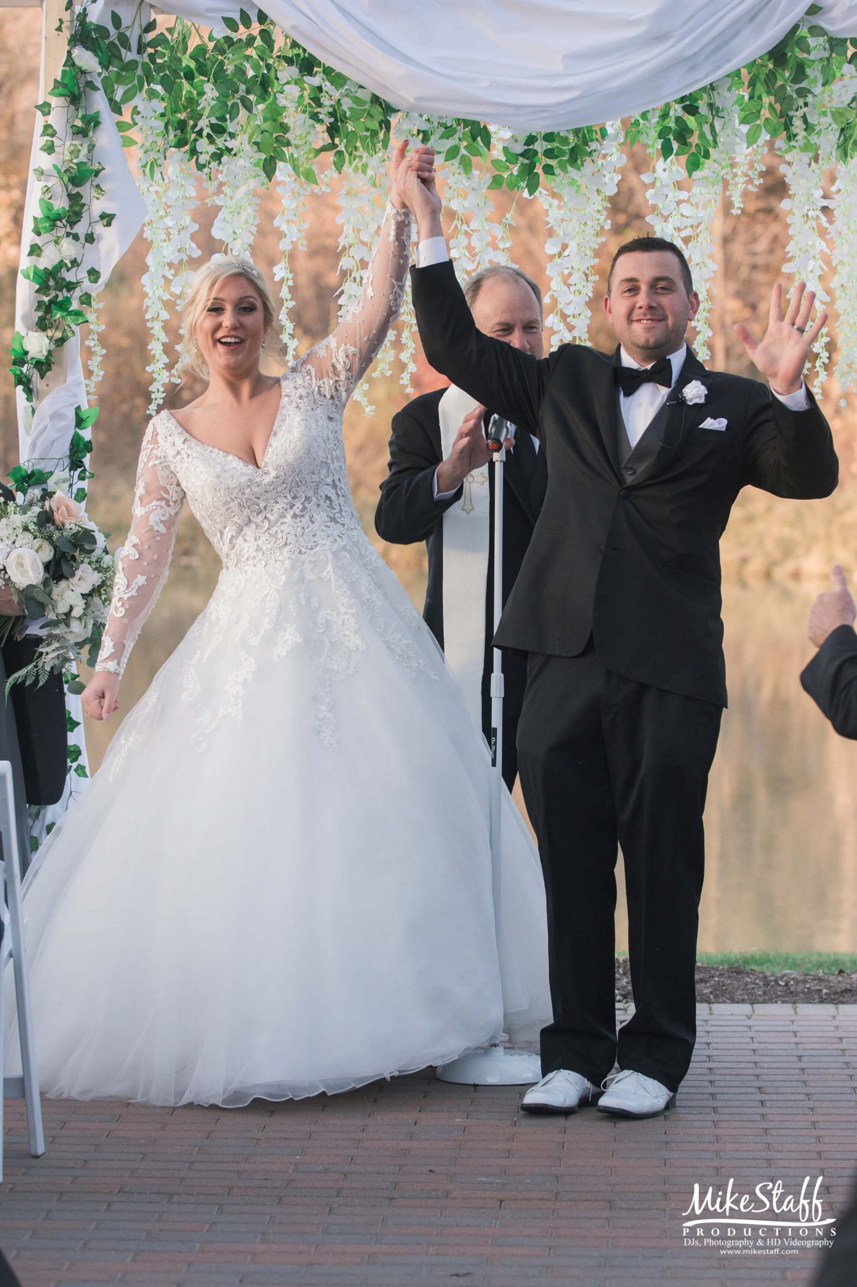 bride and groom recessional celebration