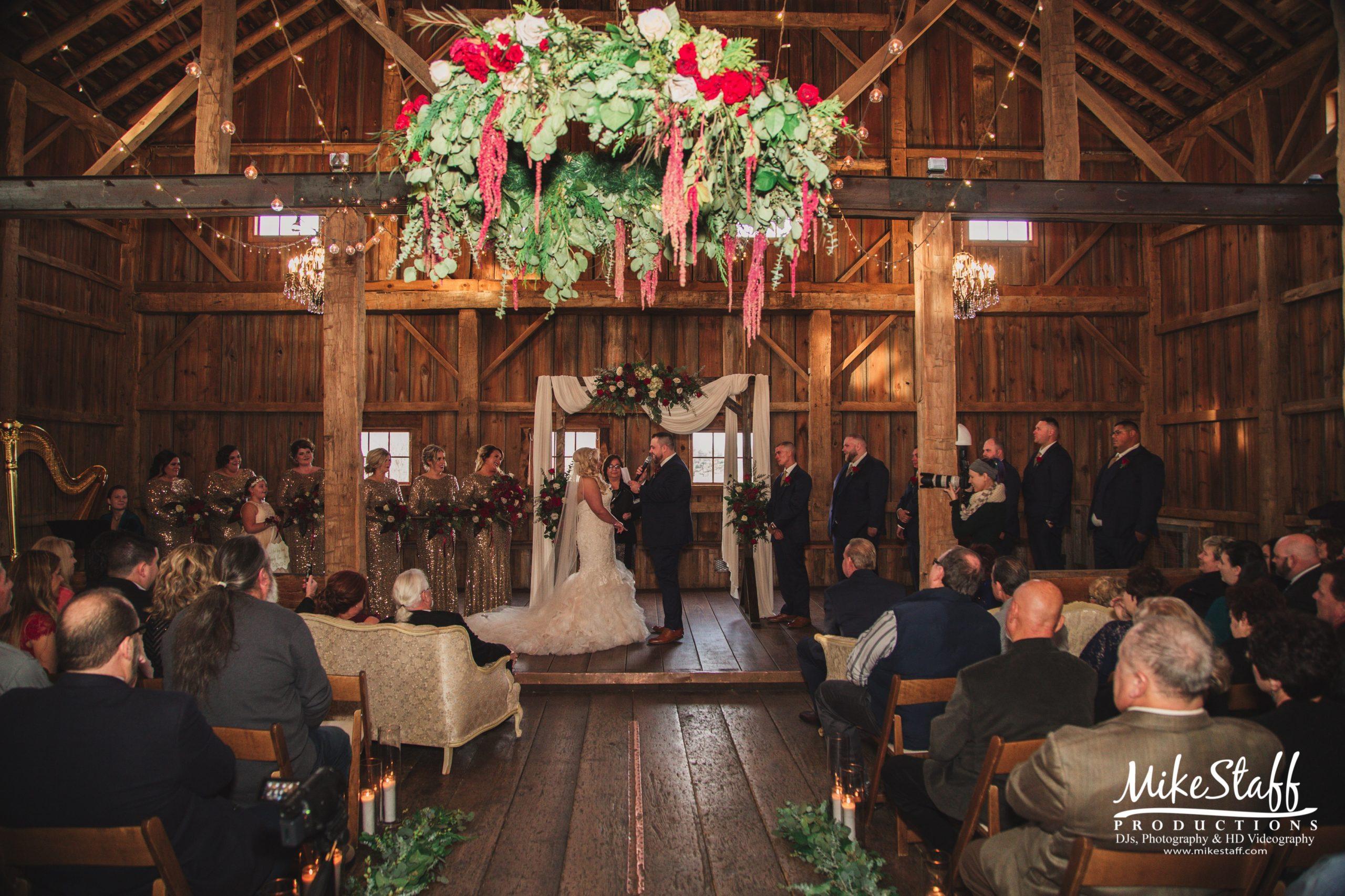 bride and groom at barn wedding ceremony