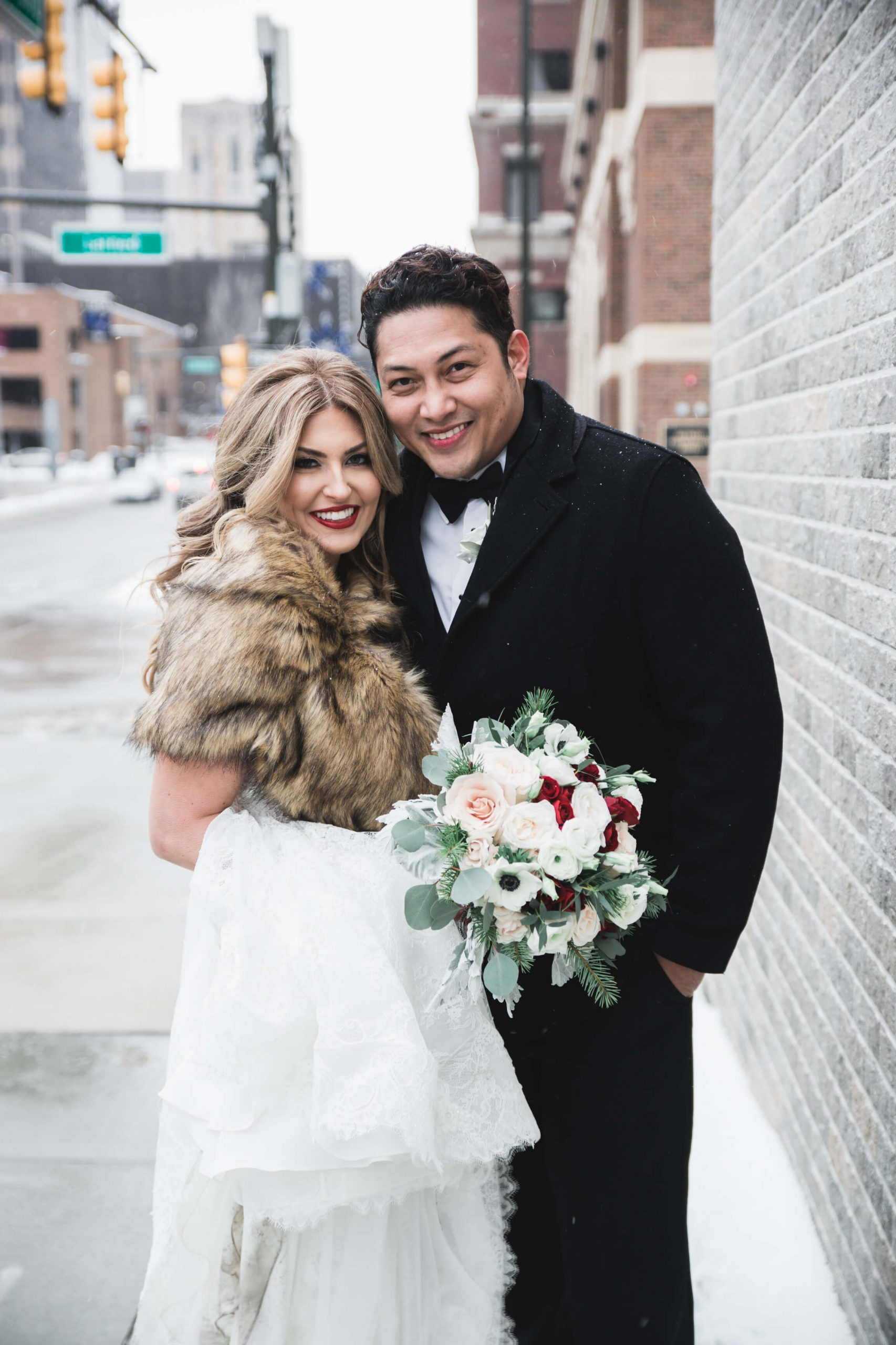 bride and groom romantics outdoors in winter