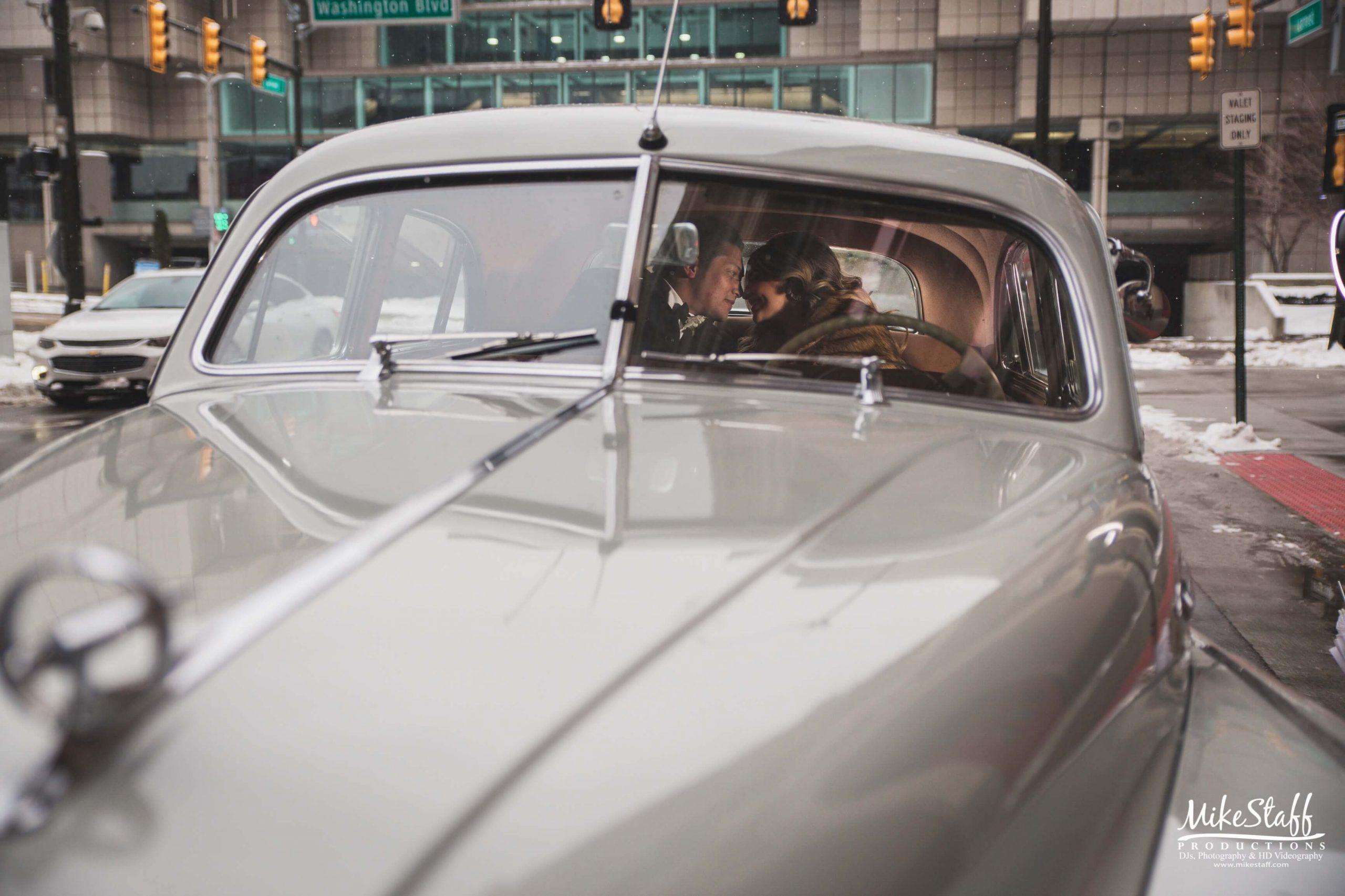 bride and groom in car in detroit