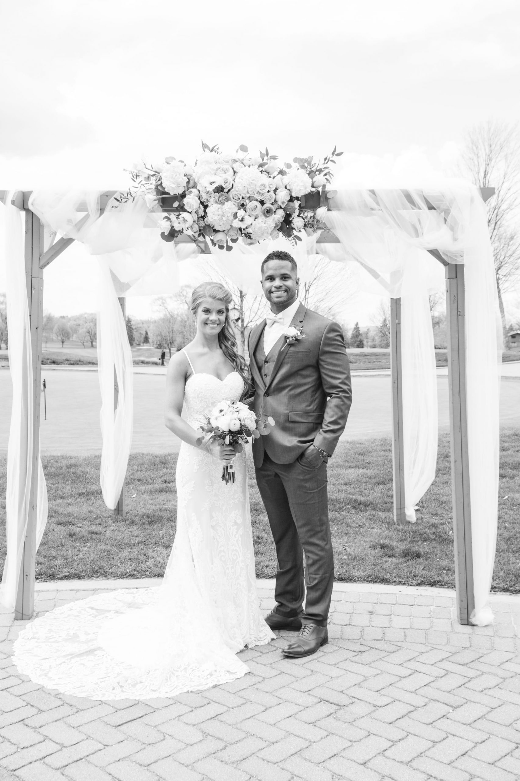 black and white portrait of bride and groom