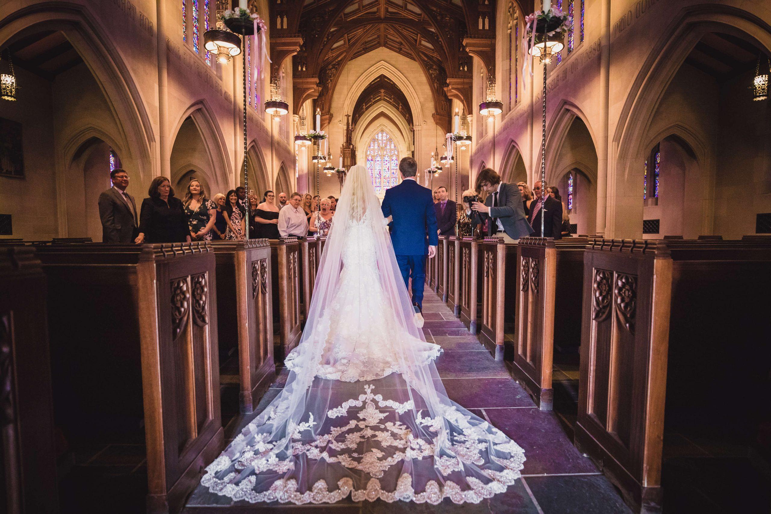 bride walking down aisle in beautiful church