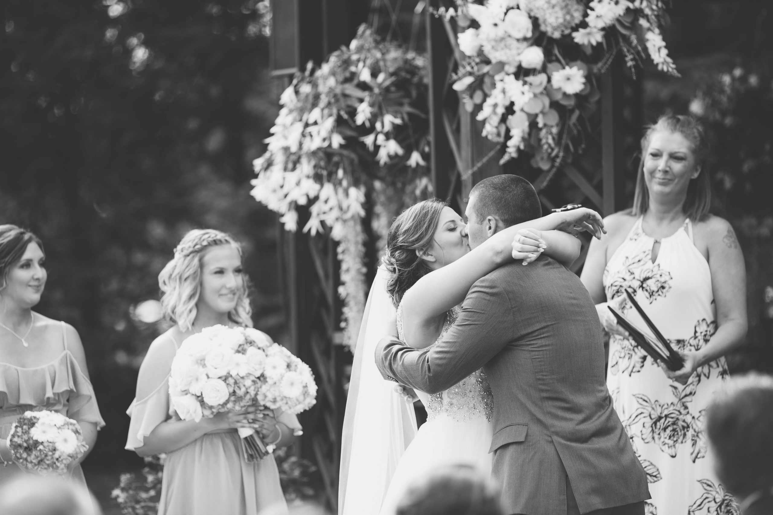 bride and groom's first kiss at ceremony
