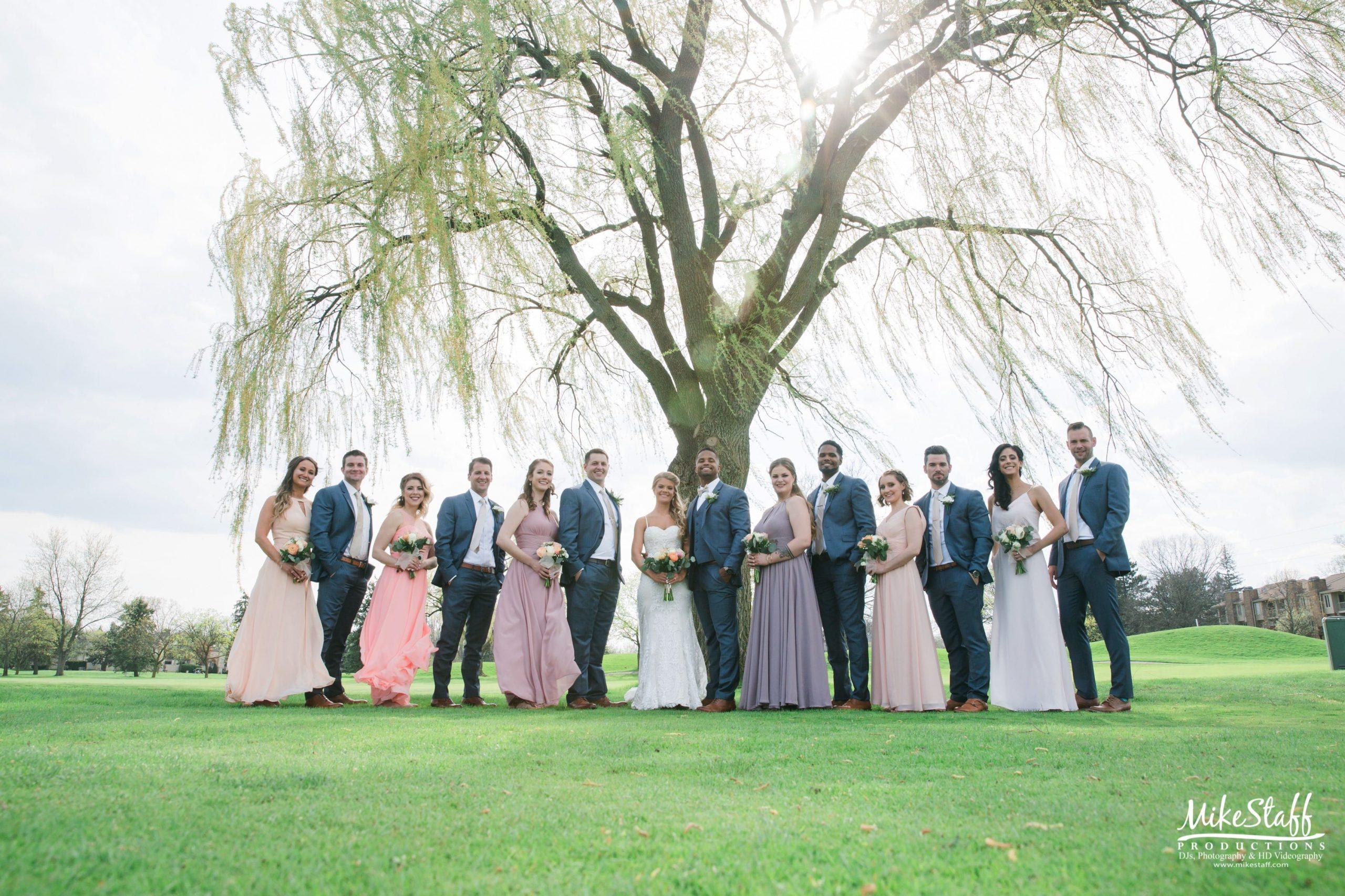 bridal party portrait on golf course