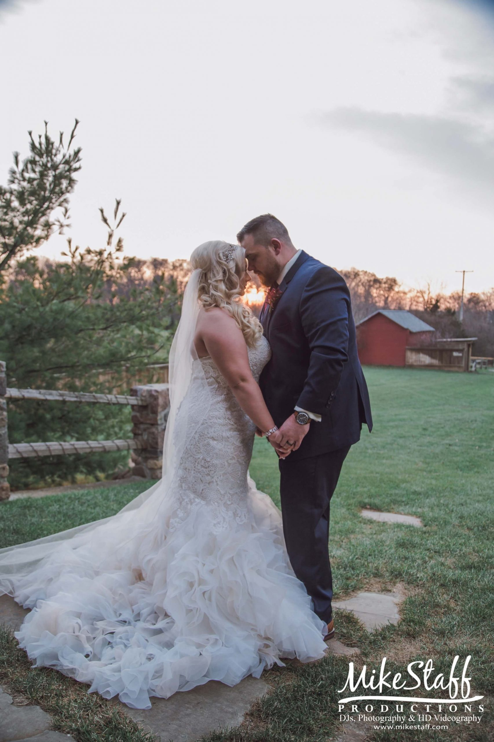 bride and groom romantics at sunset