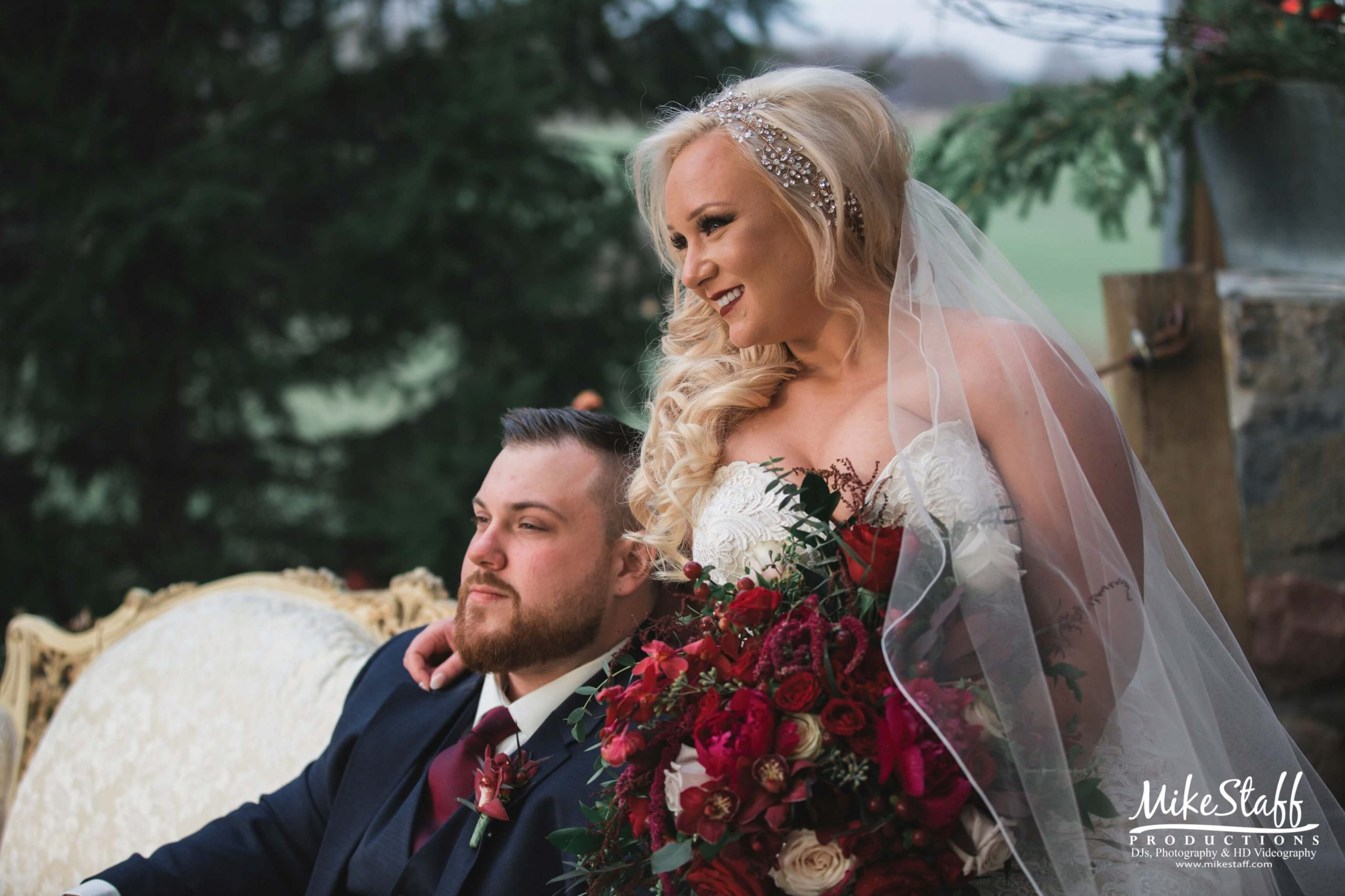 bride with arm on groom