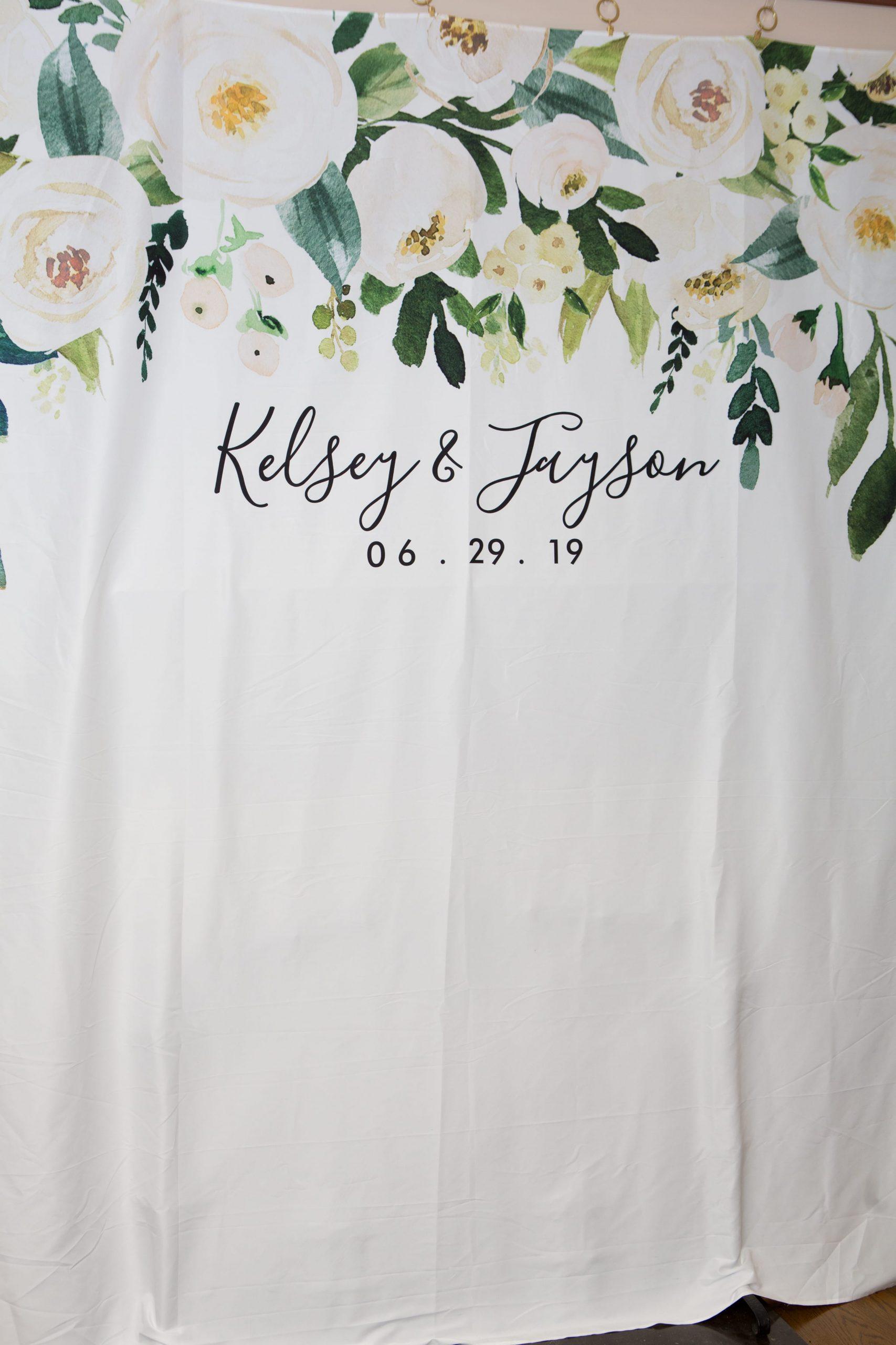 floral photo backdrop at wedding reception