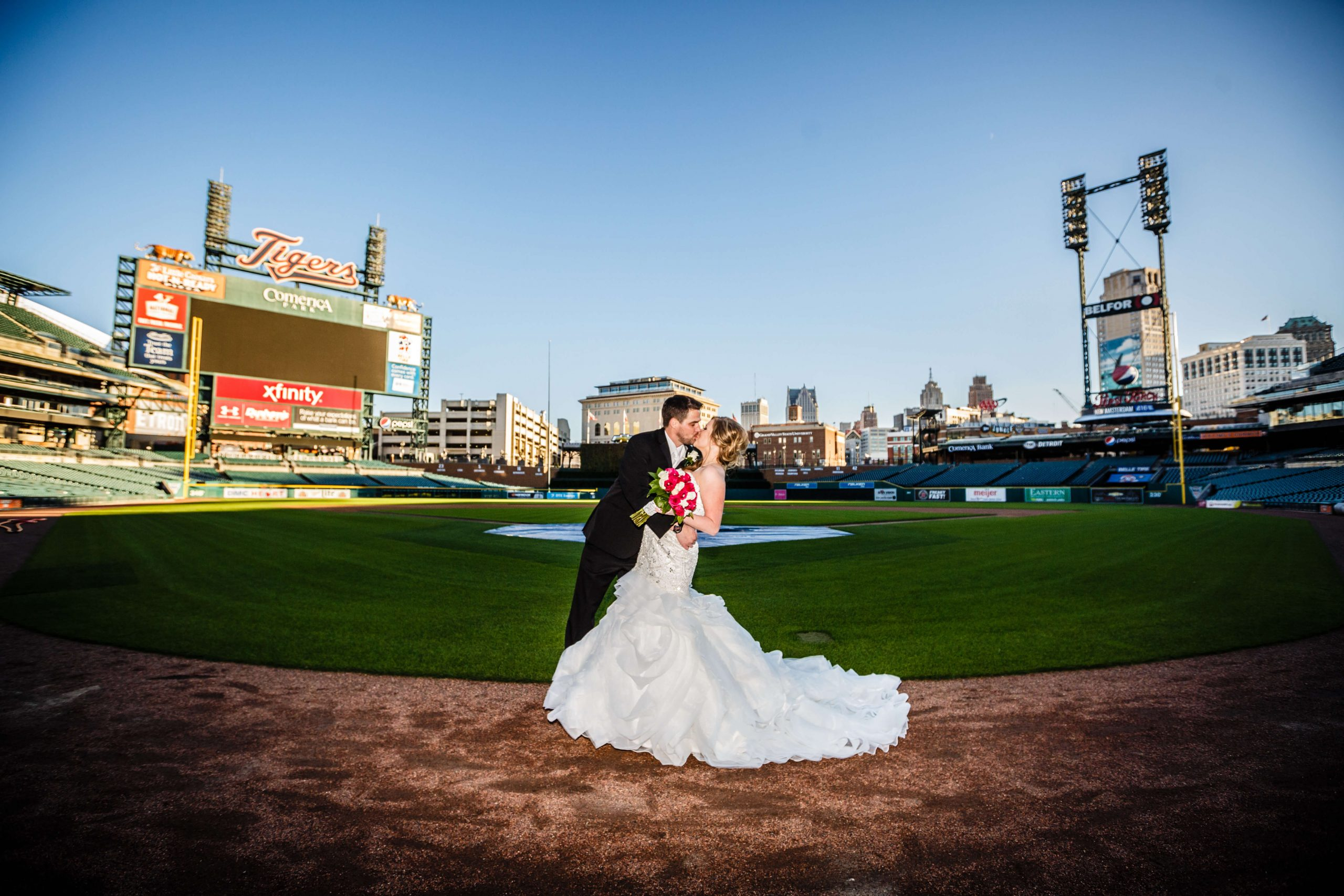 bride and groom on comerica park field