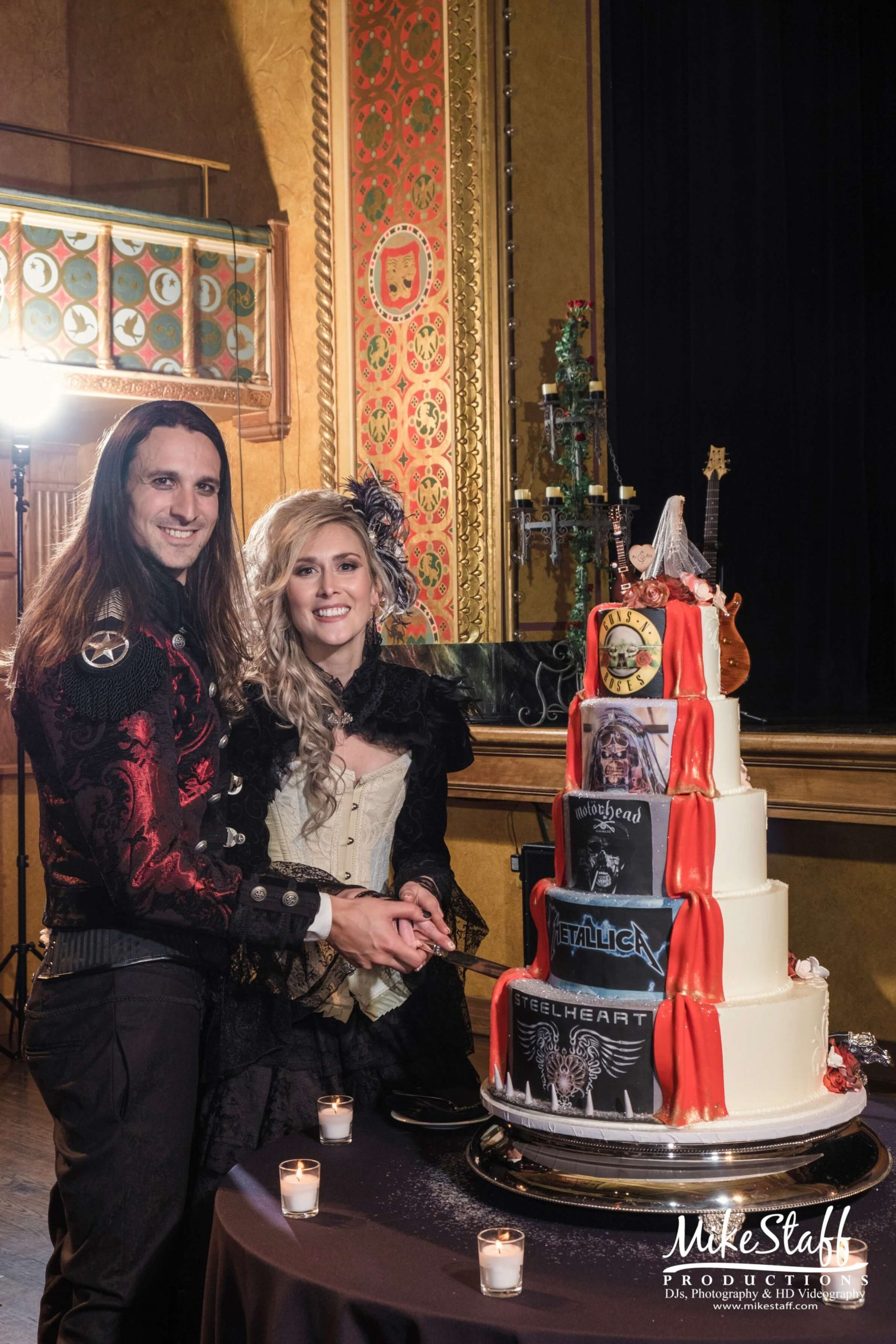 rock n roll bride and groom with cake
