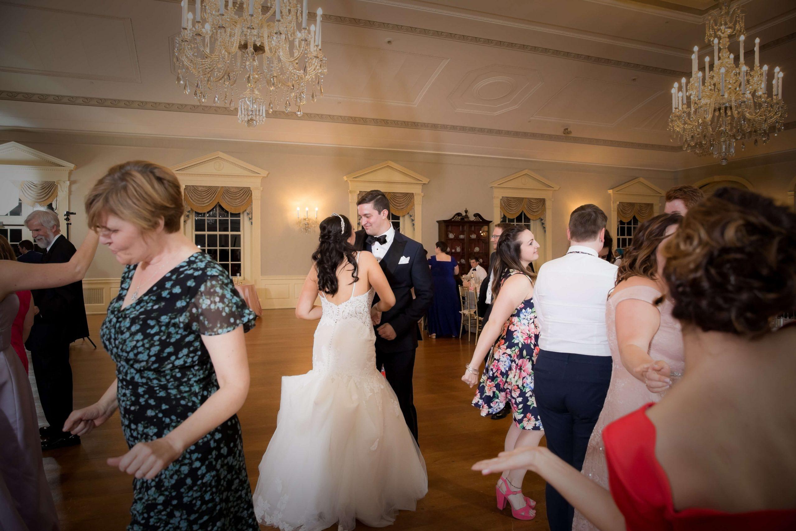 michigan wedding dj playing music for packed dance floor