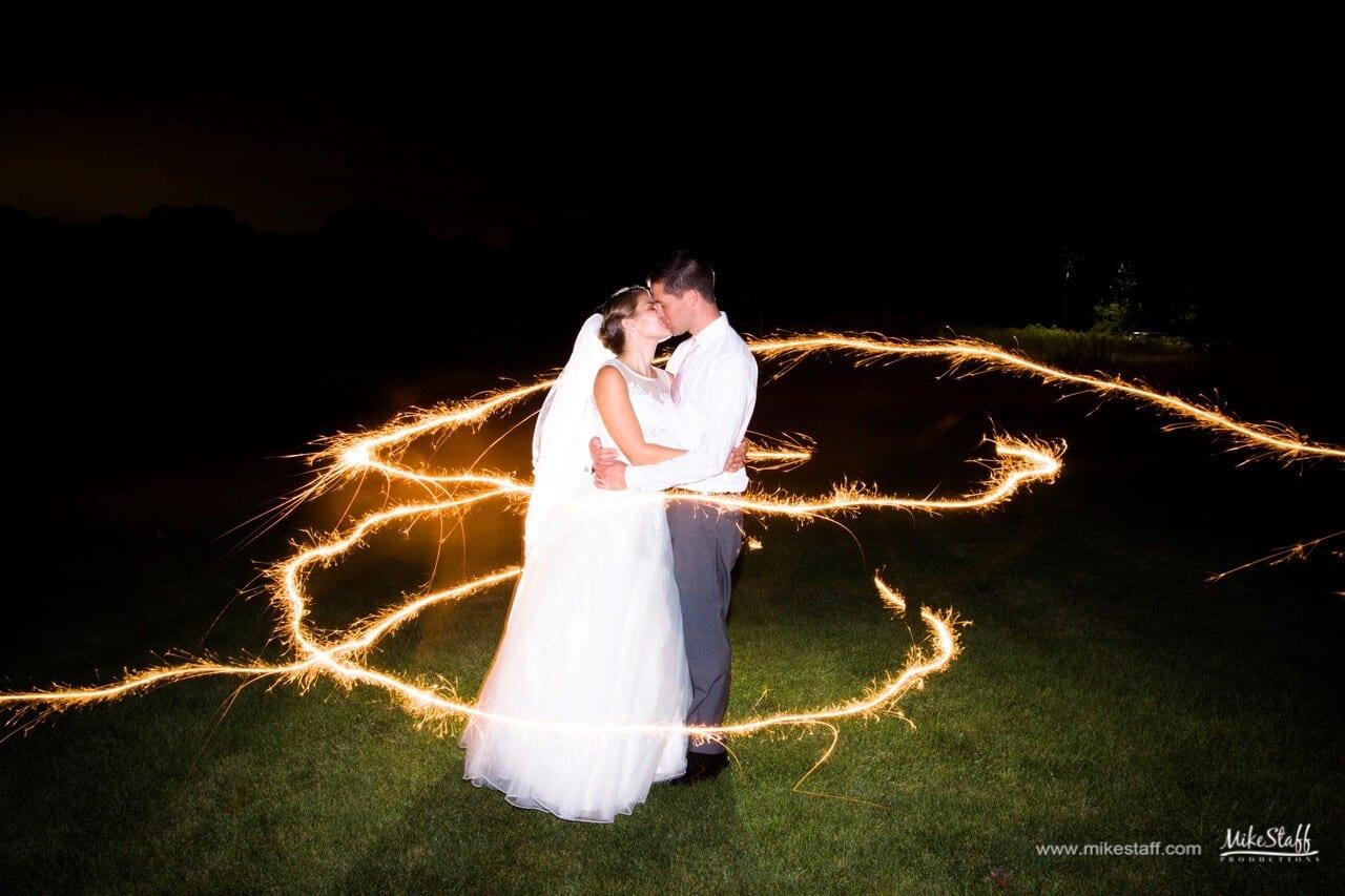 fireworks around bride and groom